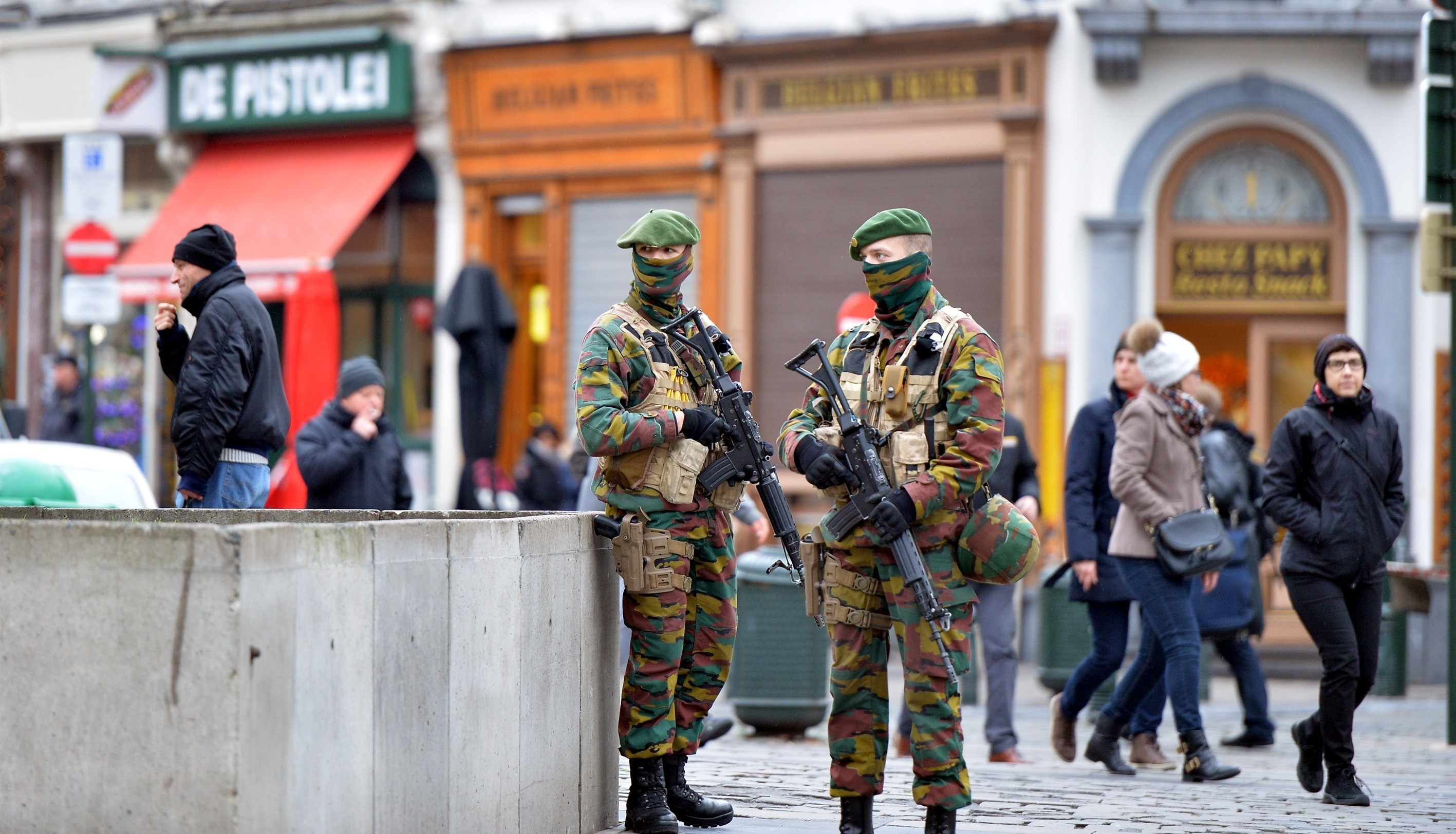 Security forces of Belgium stand guard as two people arrested on suspicion of terrorism in Brussels on Dec. 29, 2015