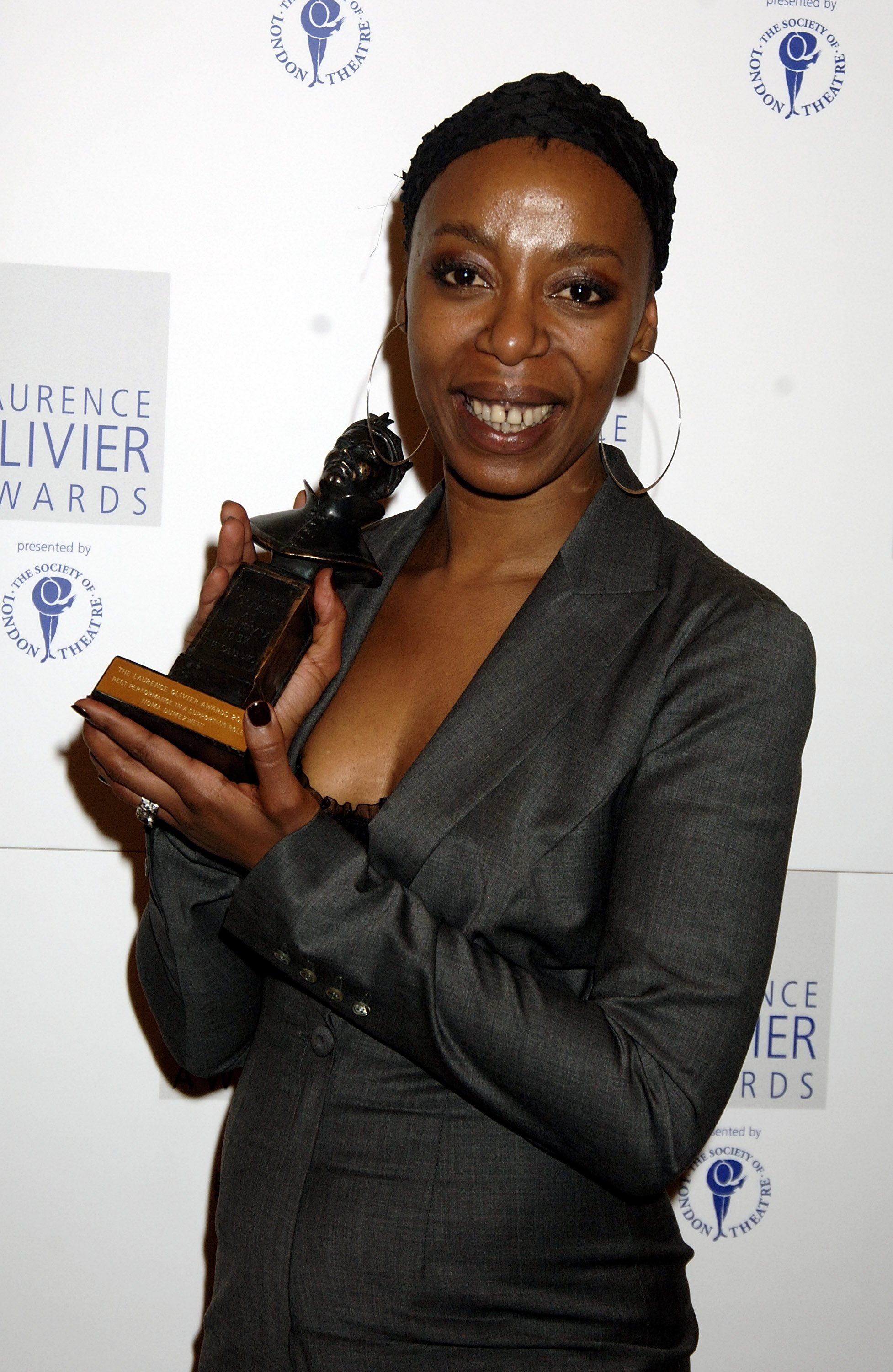 Noma Dumezweni poses with the award for Best Performance in a Supporting Role for A Raisin in the Sun at the Laurence Olivier Awards in London on Feb. 26, 2006