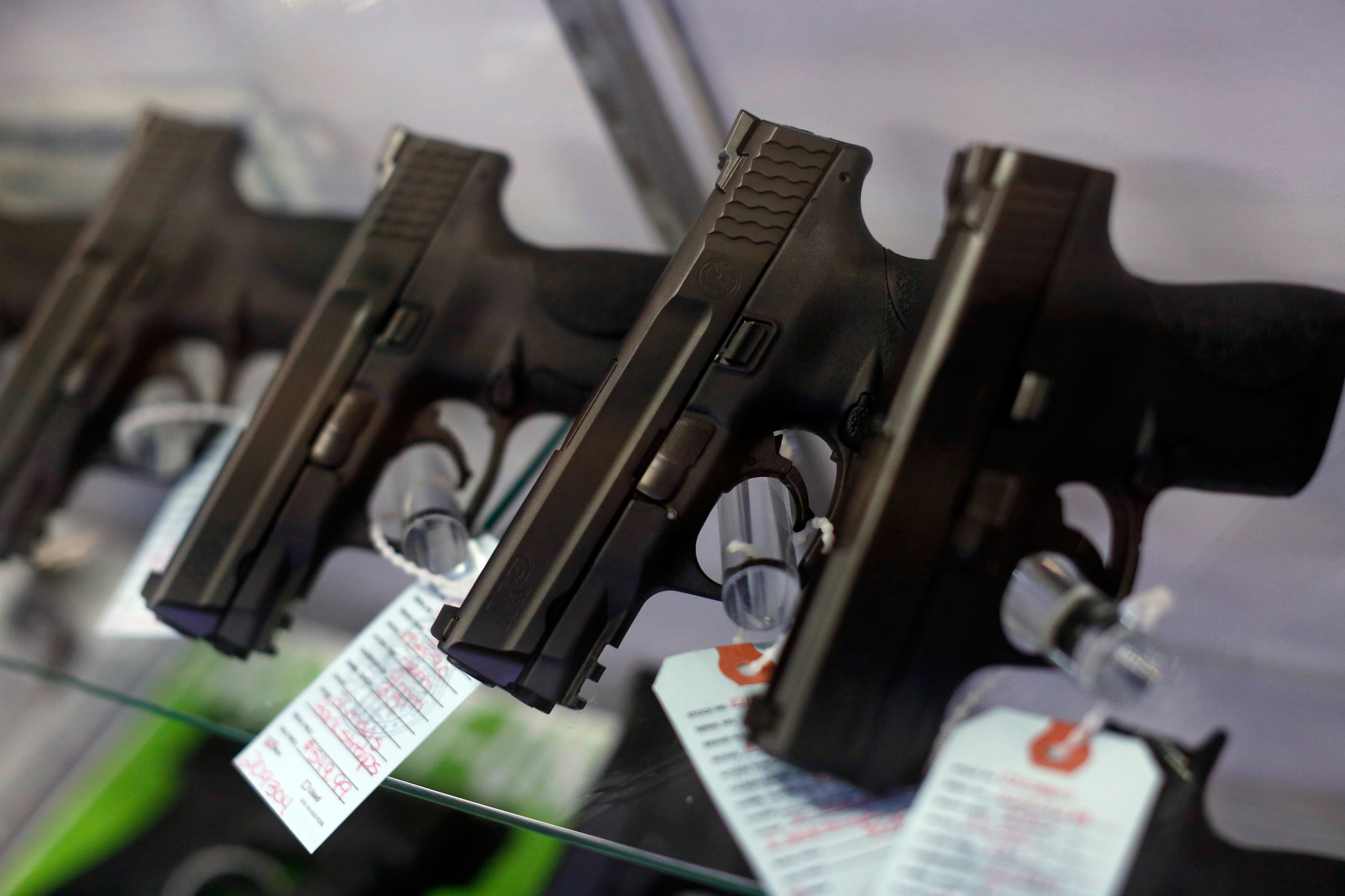 Handguns are seen for sale in a display case at Metro Shooting Supplies in Bridgeton, Miss., on Nov. 13, 2014.