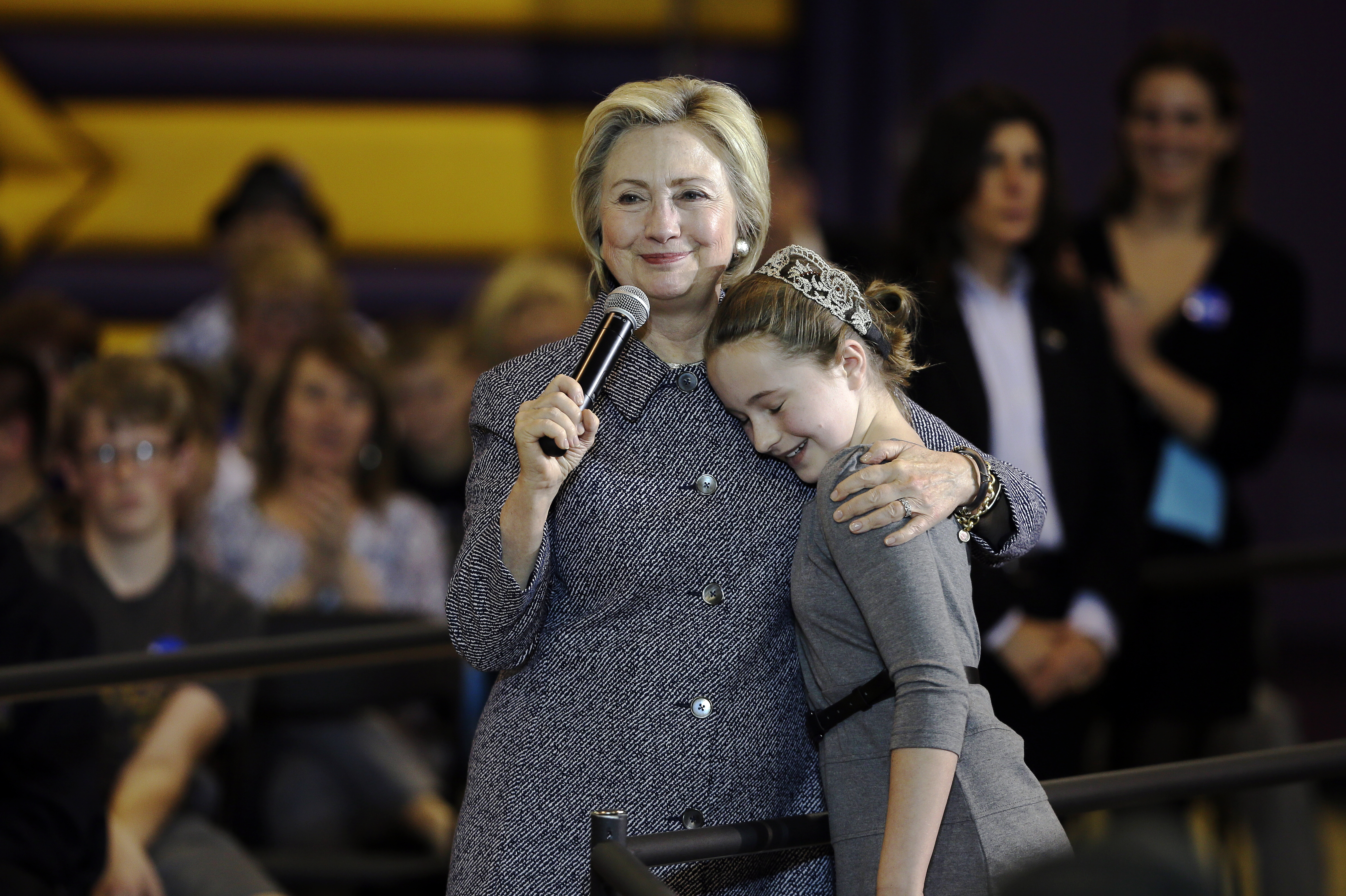 Democratic presidential candidate Hillary Clinton hugs fifth-grader Hannah Tandy during a town hall meeting at Keota High School on Dec. 22, 2015, in Keota, Iowa.