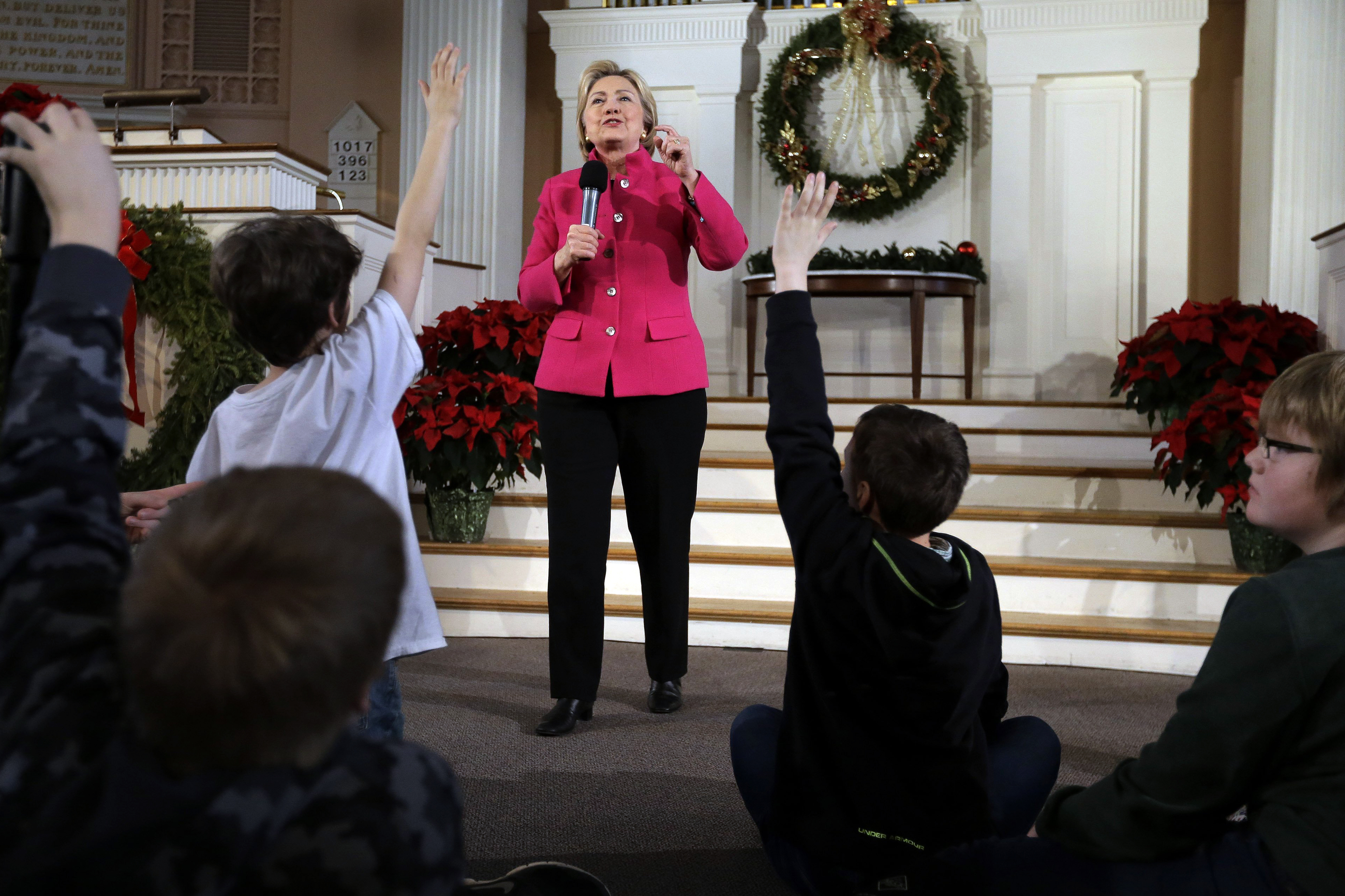 Democratic presidential candidate Hillary Clinton takes questions as children raise their hands during a town hall campaign event, Tuesday, Dec. 29, 2015, at South Church in Portsmouth, N.H.