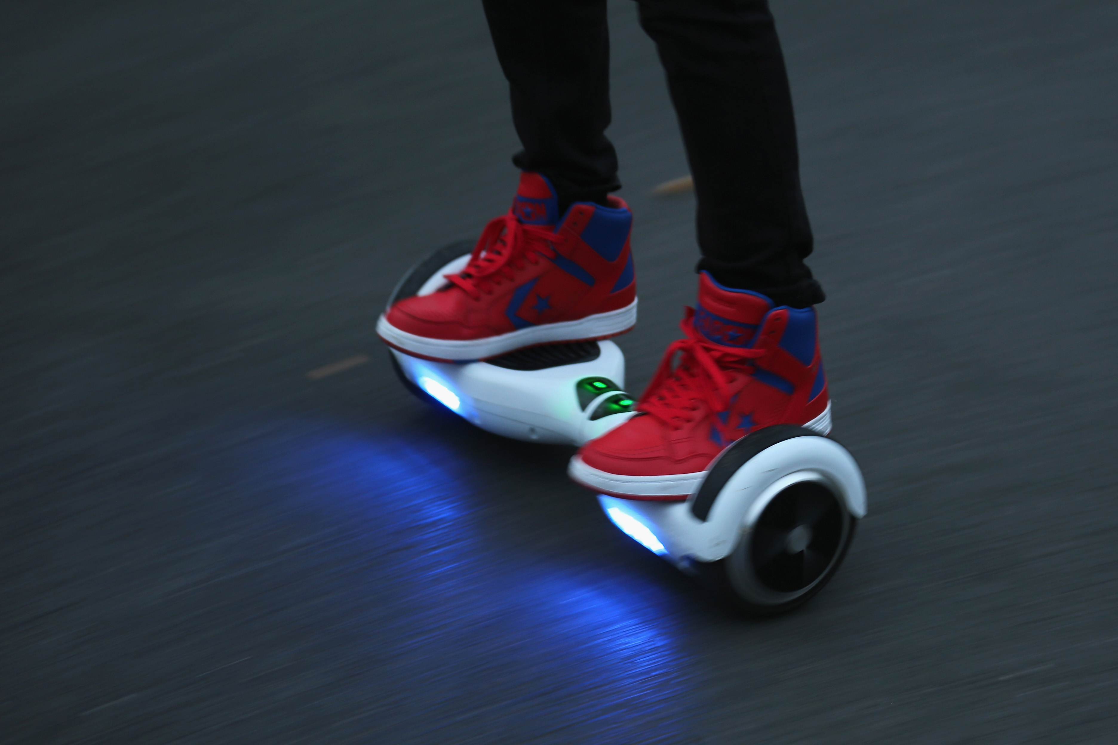 A youth poses as he rides a hoverboard, which are also known as self-balancing scooters and balance boards, on Oct. 13, 2015.
