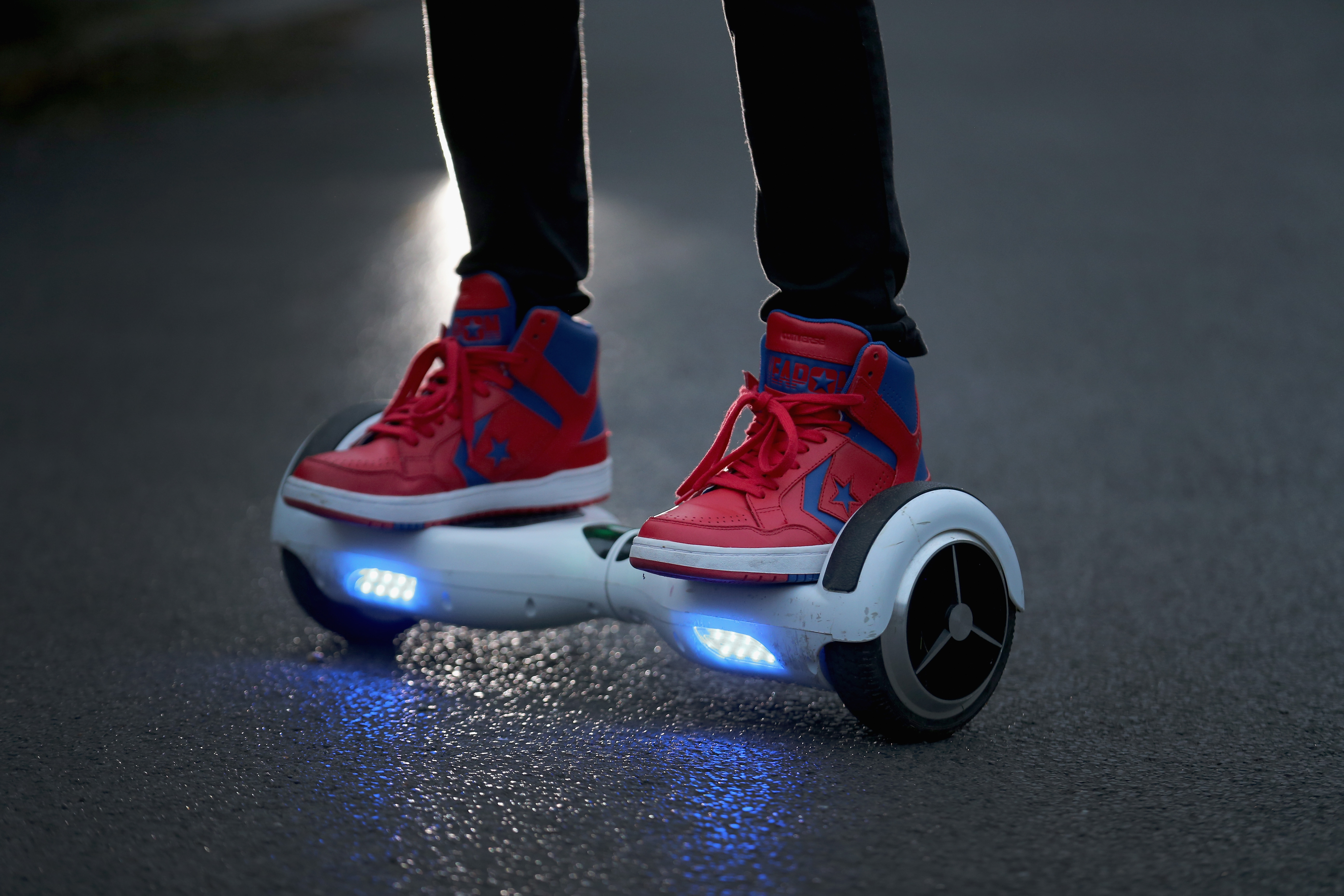 A rider on a hoverboard, which are also known as self-balancing scooters and balance boards, in Knutsford, England, Oct. 13, 2015.