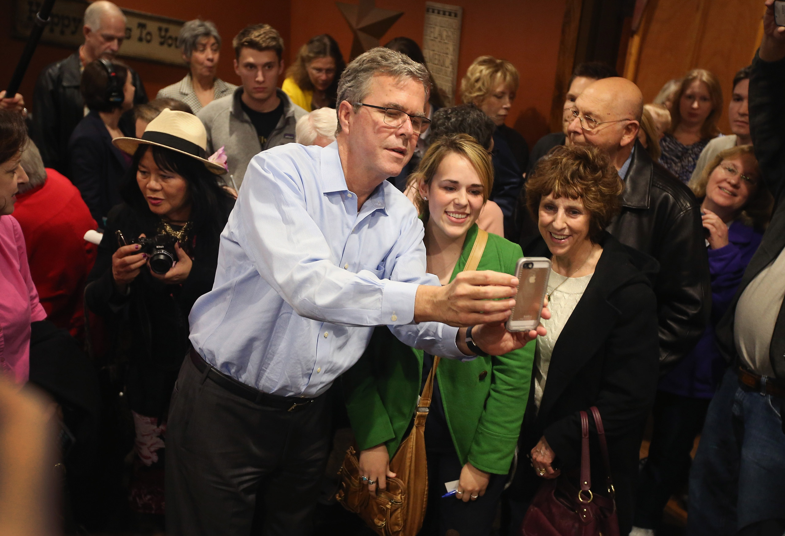 Jeb Bush takes a selfie with Iowa residents after speaking at a Pizza Ranch restaurant in Cedar Rapids, Iowa, on March 7, 2015.