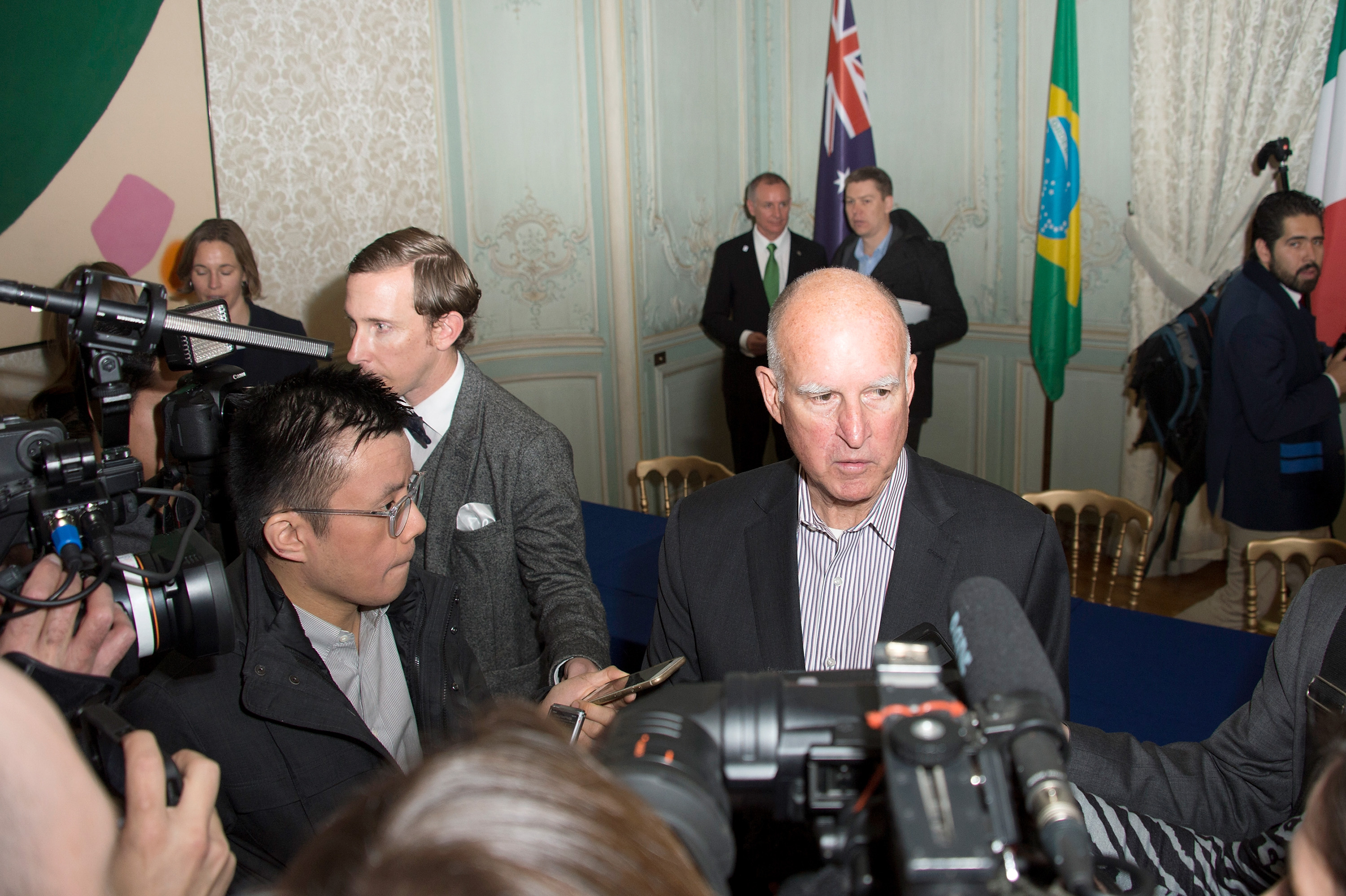 California Governor Jerry Brown speaks to the press after the signing of the memorandum on subnational global climate leadership on Dec. 6, 2015 in Paris.