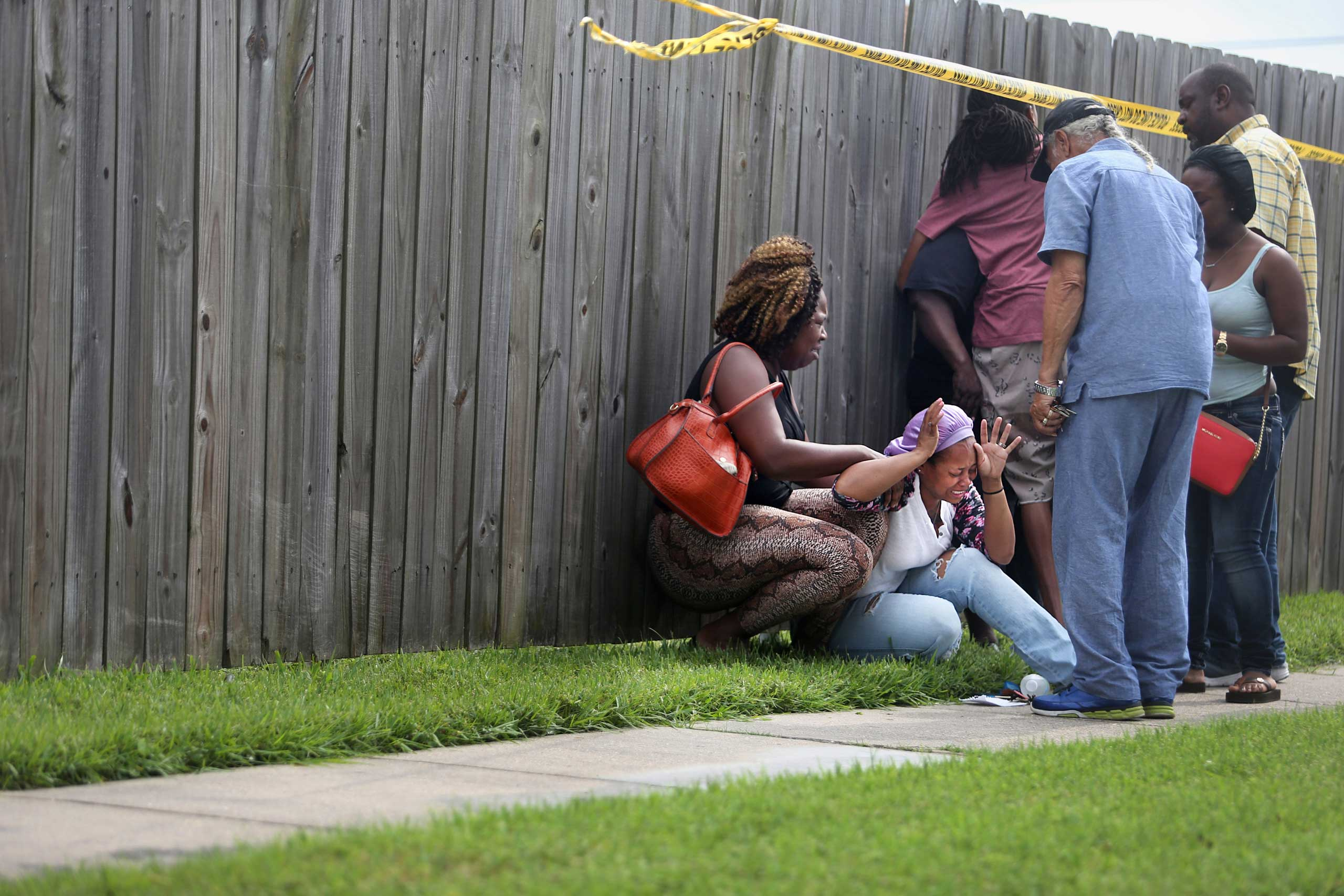 The mother of two men killed in a double homicide in eastern New Orleans reacts after confirmation of their identities came from police. New Orleans, La. May 25, 2015.
