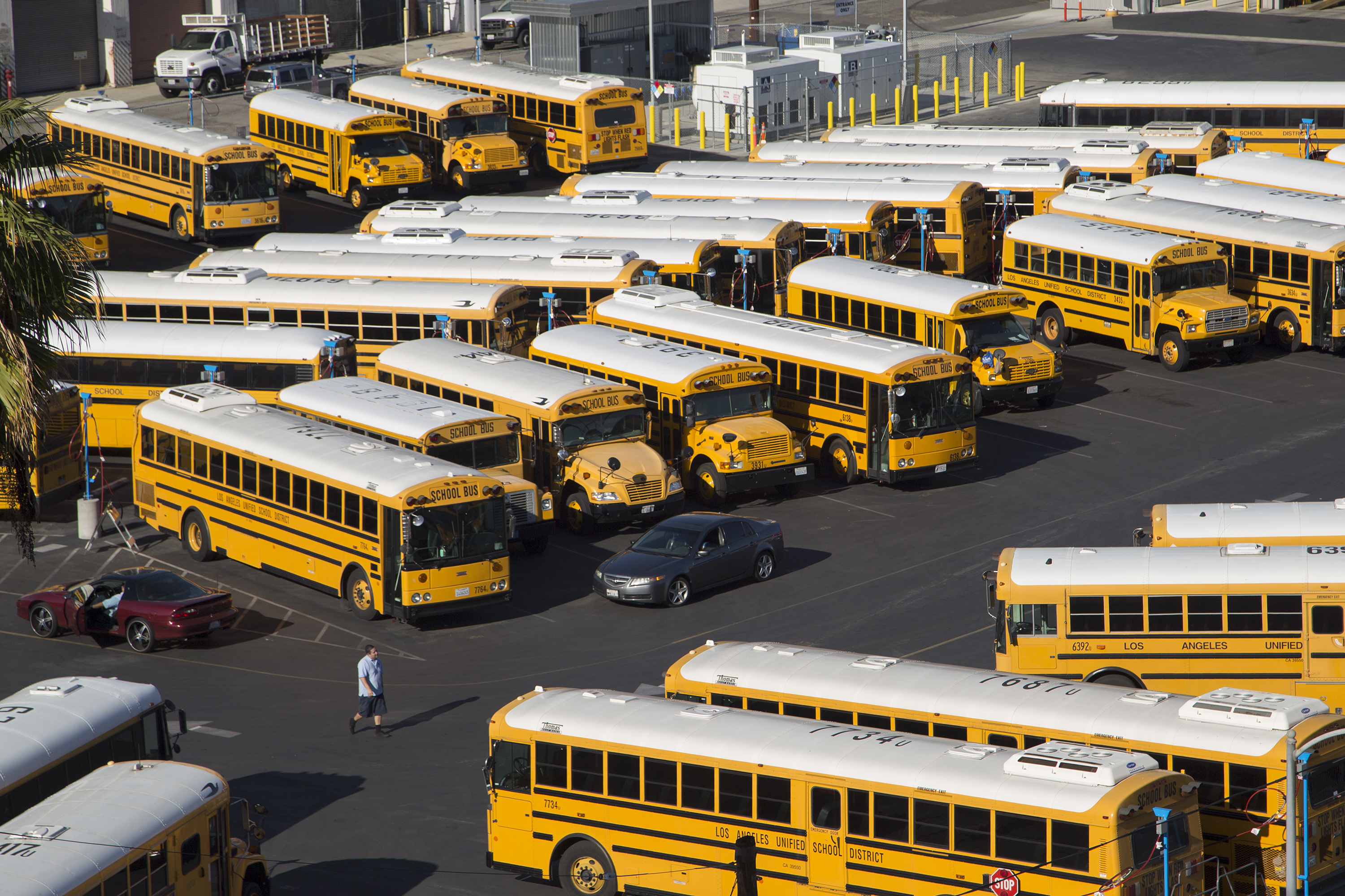 School buses stand idle as all Los Angeles city schools are shut down in reaction to a threat on December 15, 2015 in Los Angeles, California. A  bomb threat against LAUSD schools was sent to various members of the Los Angeles school board late last night, according to LAPD Chief Charlie Beck. Local authorities immediately notified the FBI.