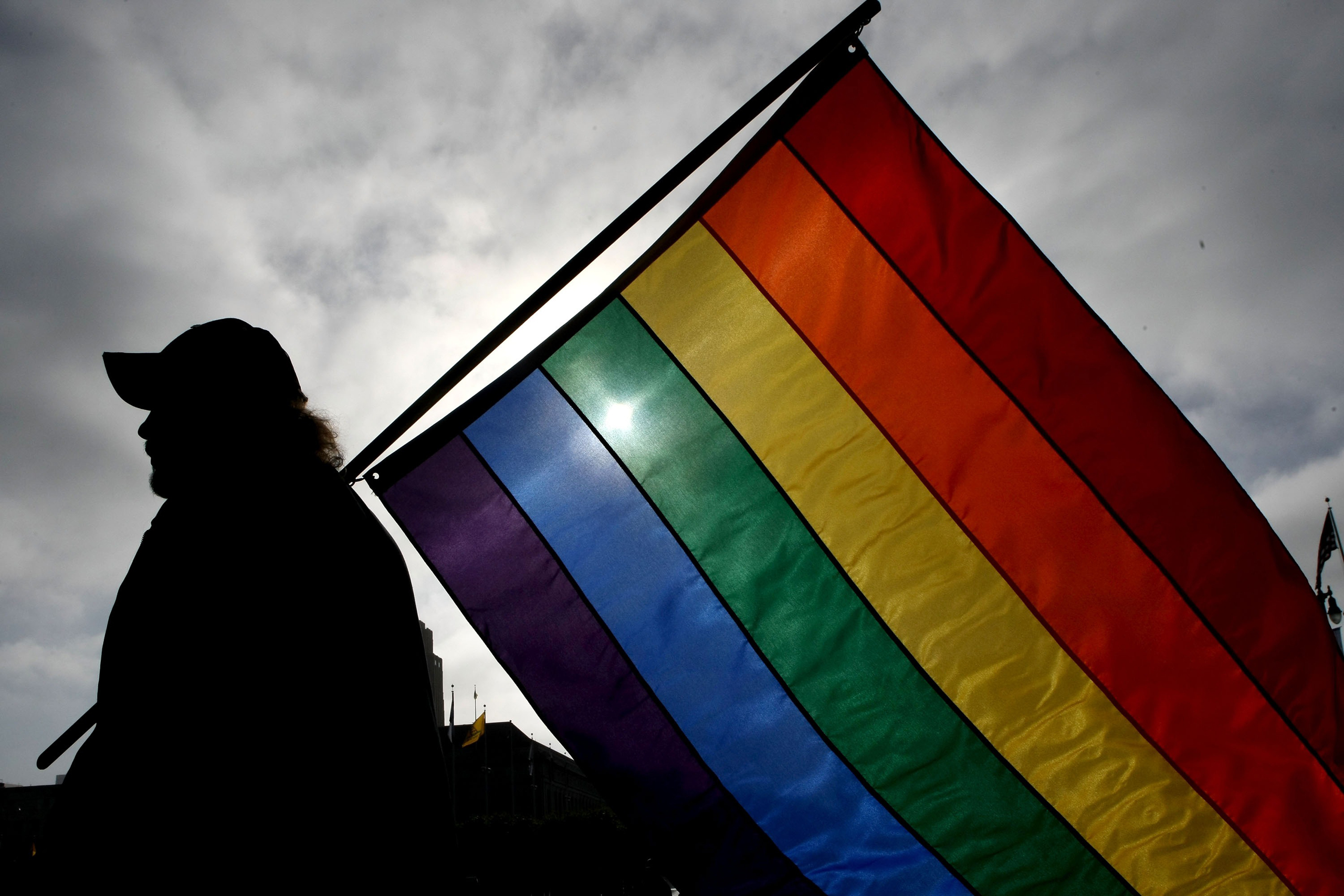 A man holds a gay-pride flag in San Francisco in 2008, when same-sex marriage first became legal in California.