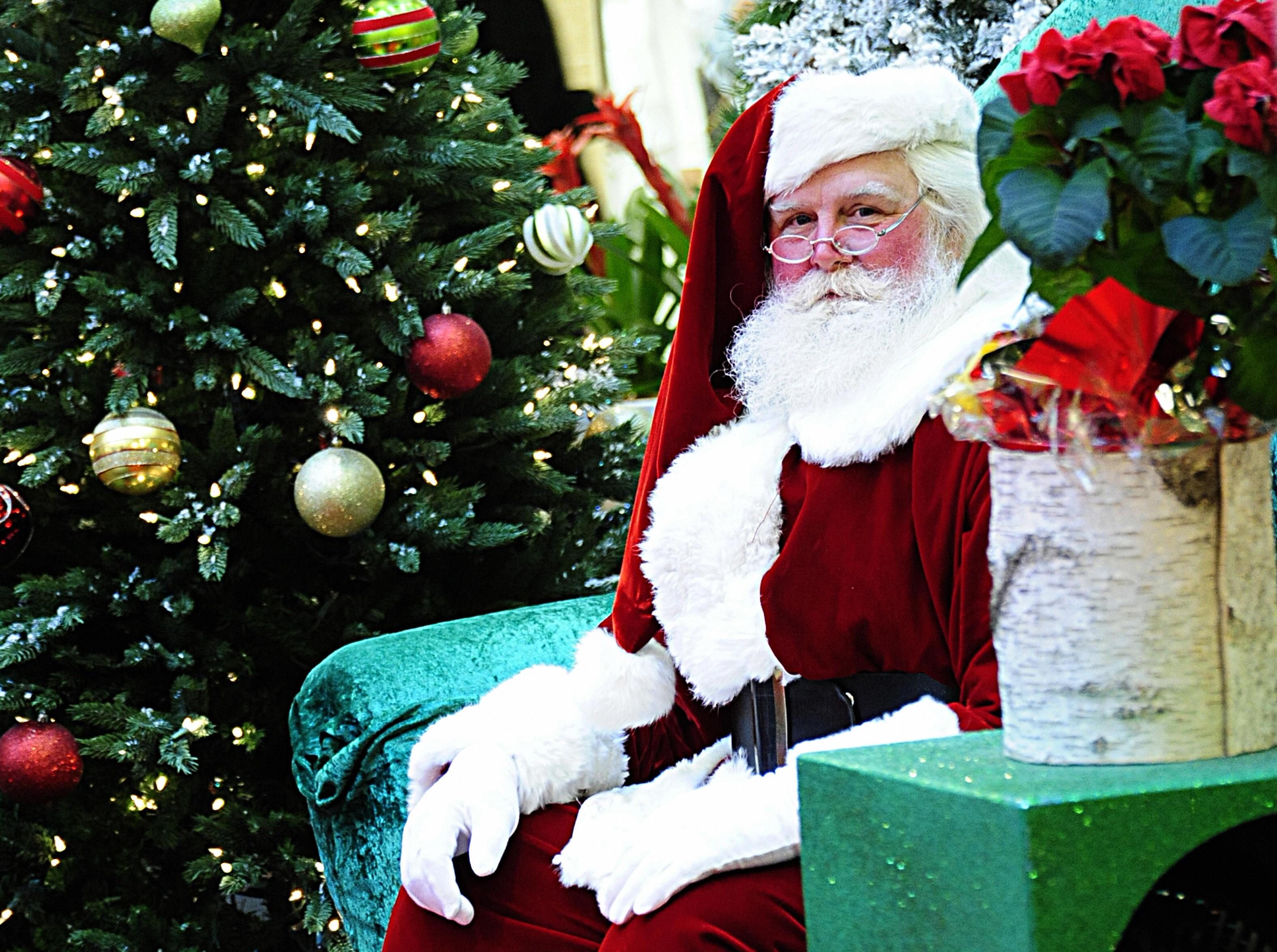 Santa Claus waits to greet children at the Tysons Corner mall in Tysons Corner, Virginia, on Dec. 20, 2008.
