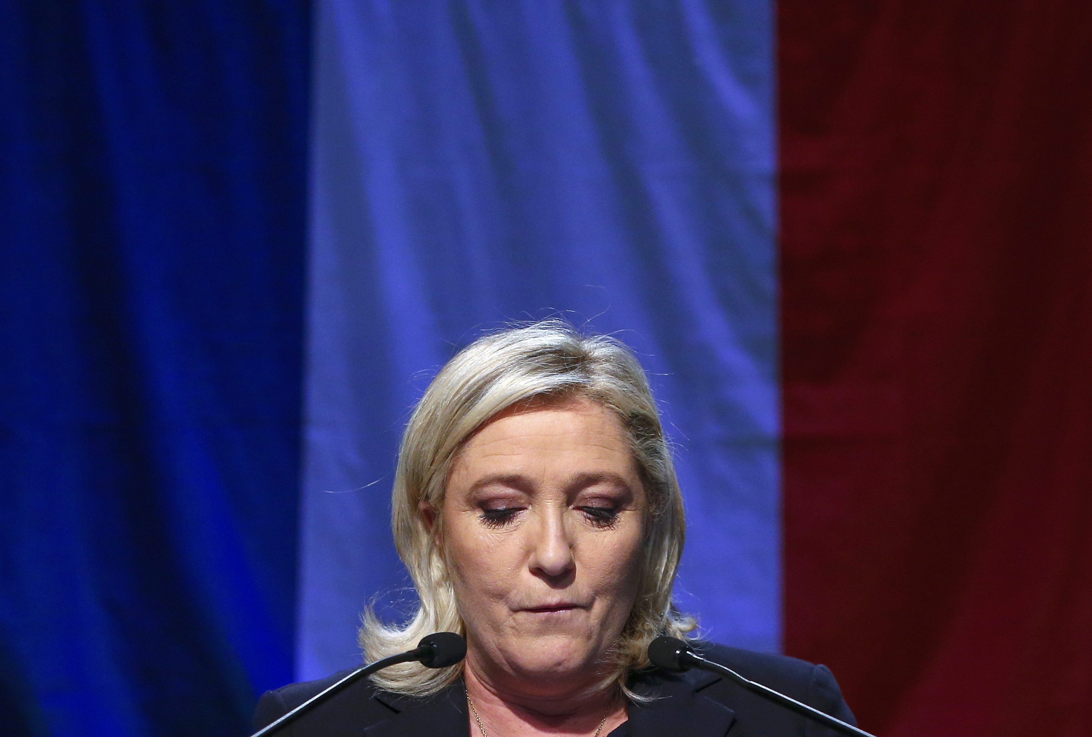 Marine Le Pen, French National Front (FN) political party leader and candidate for the National Front in the Nord-Pas-de-Calais-Picardie region, delivers a speech after results in the second-round regional elections in Henin-Beaumont, France, Dec. 13, 2015.