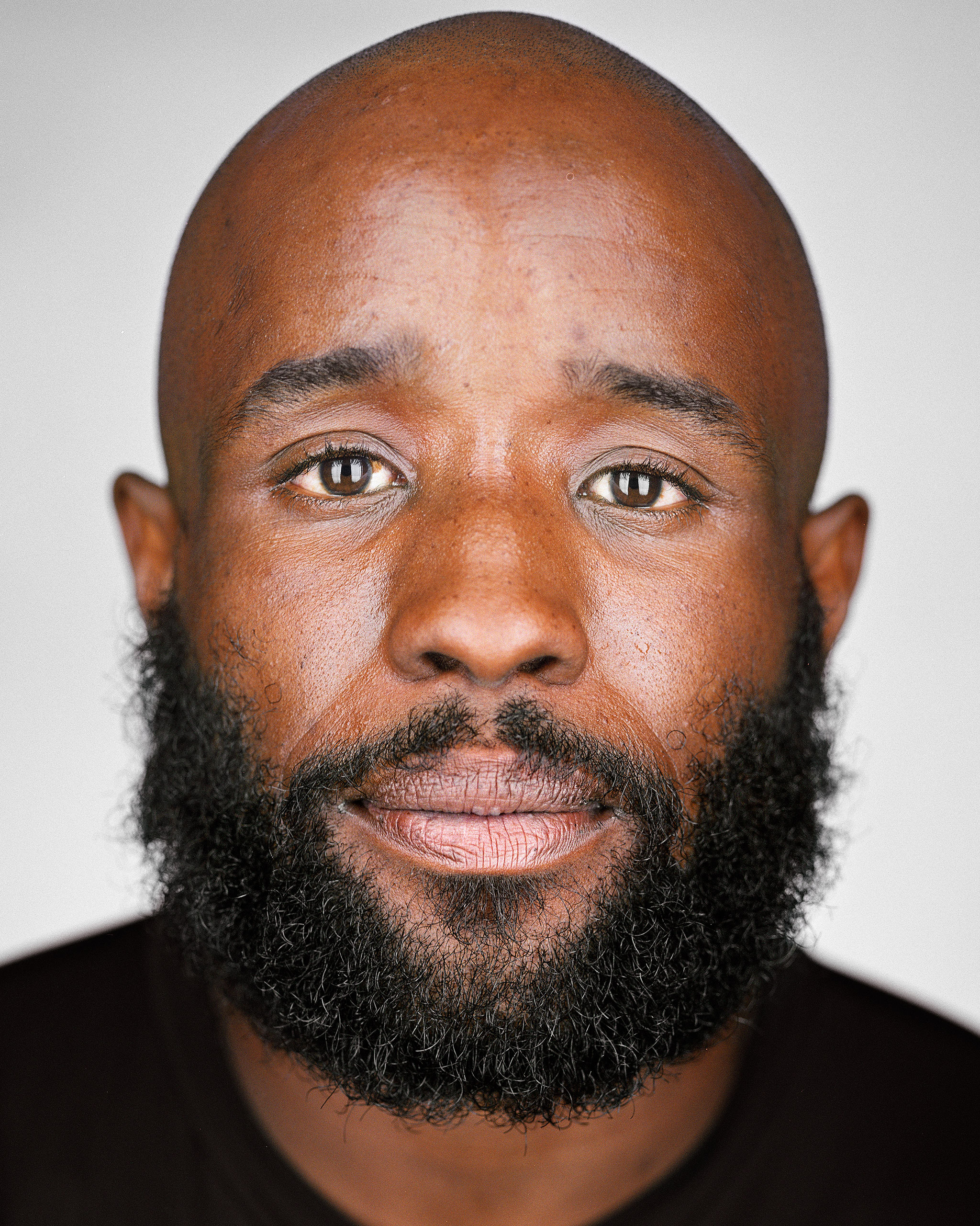 """Martin:  How long have you been out here on the streets?""""                               Markeith: """"I've been out here since 2004. I was in tenth grade. My mother passed away and left me kinda...My dad's a crack head so I didn't really have too much family. I'm from the Highlands. I been out here for quite awhile. But I try to be upbeat about it.""""                               Martin: """"You quit school at grade ten then?""""                               Markeith: """"Yeah.""""                               Martin: """"Your mom must have been really young when she passed away, man.""""                               Markeith: """"Yeah, she was late thirties.""""                                                              Martin: """"Drug related?""""                                Markeith: """"She was shot in the spinal cord. Her boyfriend was selling drugs. They came lookin' for him and killed my mom. That's why I'm trying to keep myself away from all of that.""""                                                               —Markeith Watson, Oct. 27, 2015."""