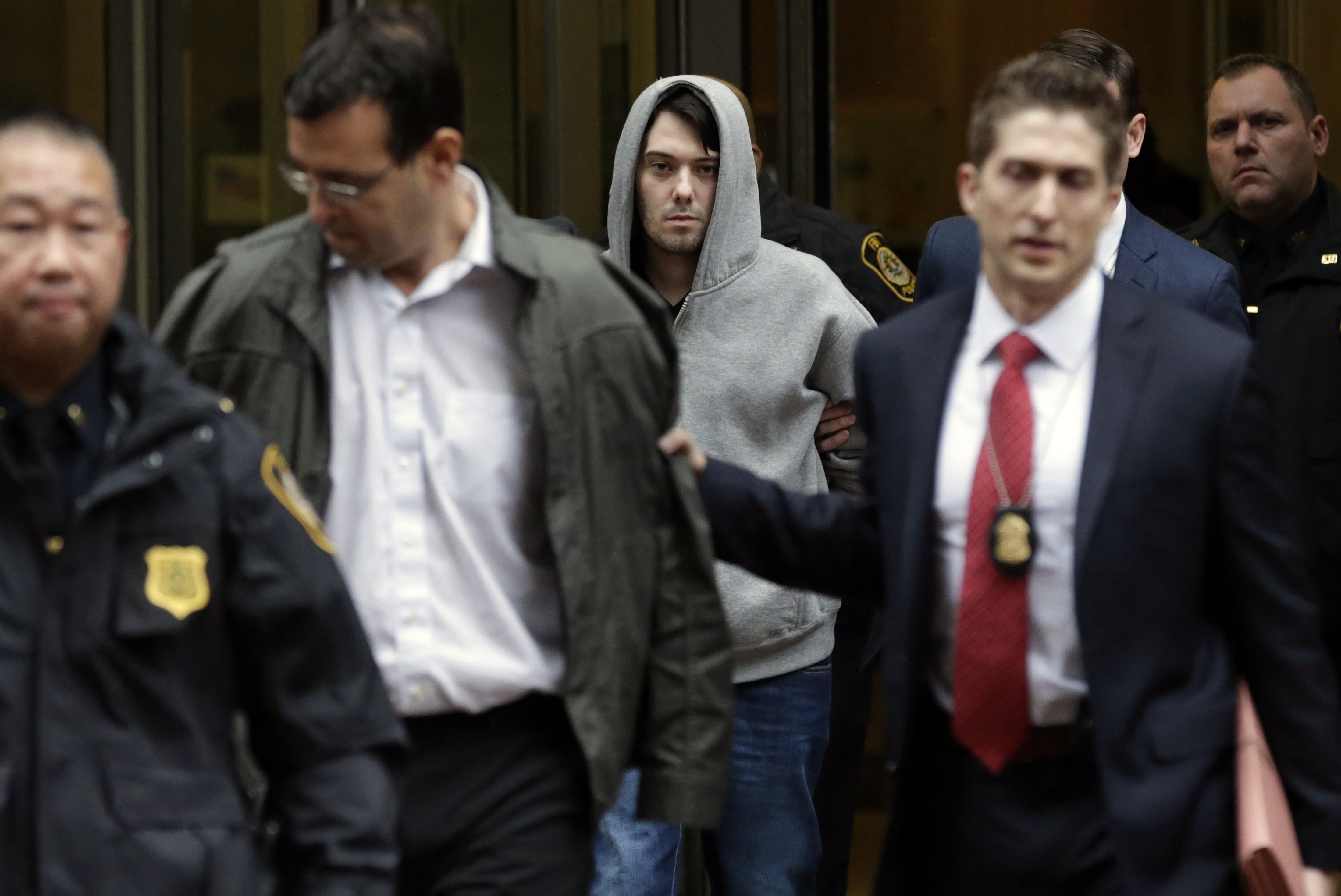 Martin Shkreli, chief executive officer of Turing Pharmaceuticals LLC, center, and attorney Evan Greebel, left, exit federal court in New York, U.S., on Thursday, Dec. 17, 2015.