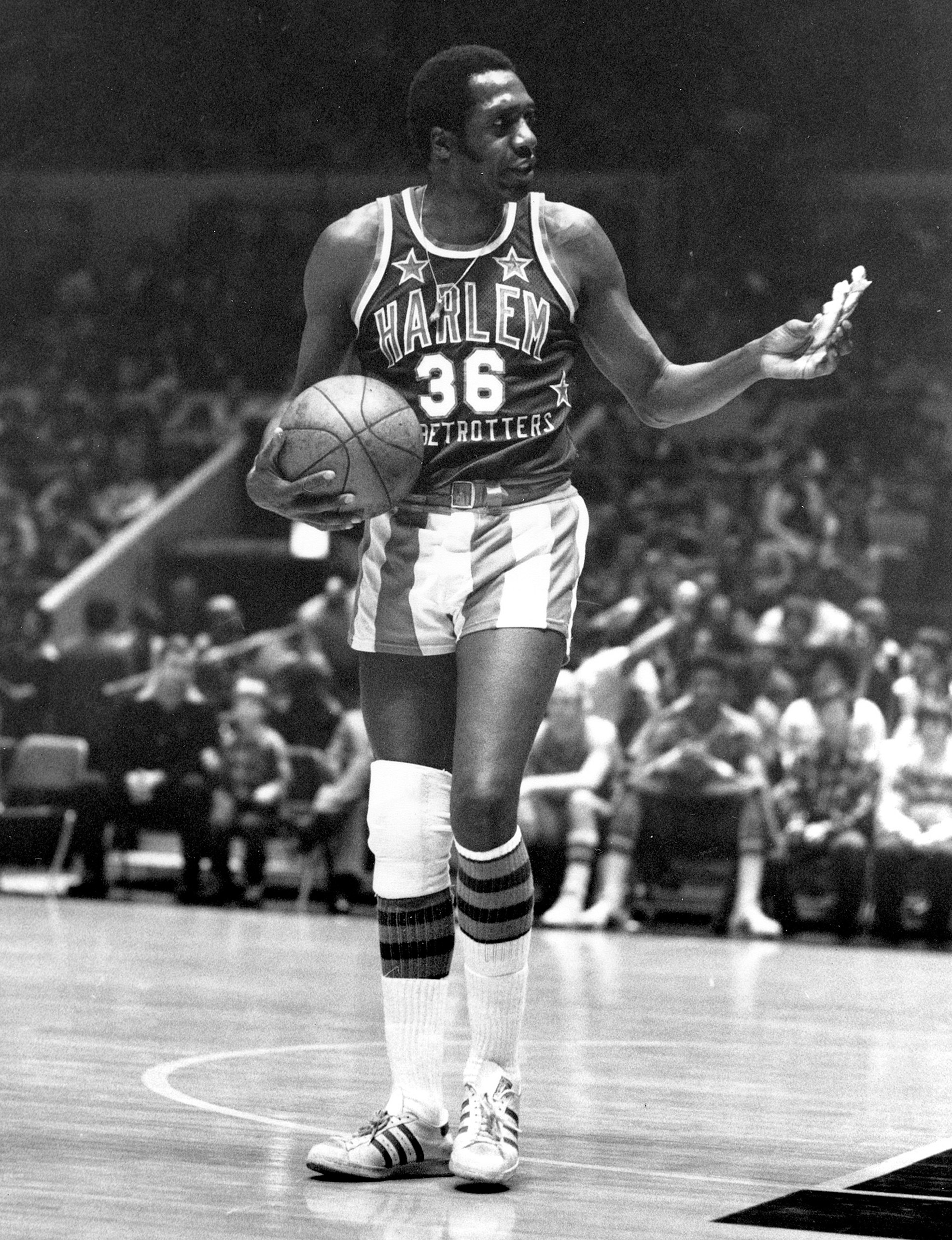Meadowlark Lemon of the Harlem Globetrotters basketball team offers a pretzel to a referee during a game at New York's Madison Square Garden in New York on Feb. 18, 1978.