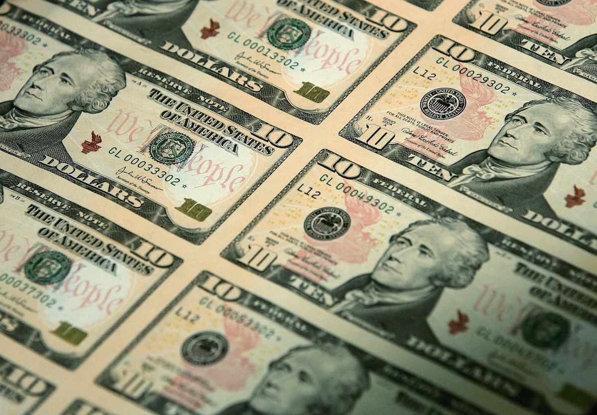An uncut sheet of the redesigned $10 bill is seen after a news conference to commemorate the first day of circulation of the new notes at the National Archives March 2, 2006 in Washington, DC.