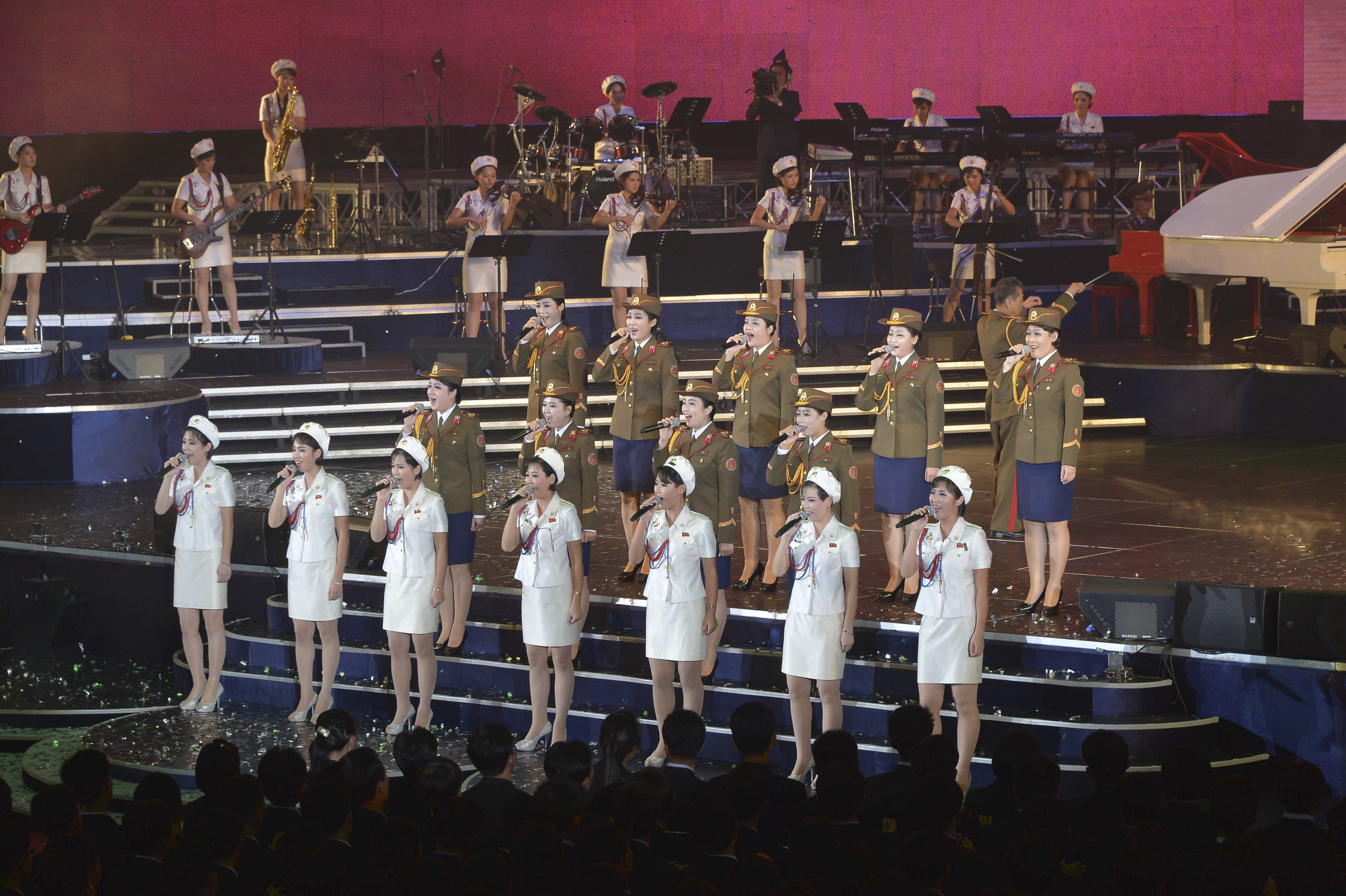 Members of the Moranbong Band and the State Merited Chorus take part in a joint performance to celebrate the 68th anniversary of the Workers' Party of Korea (WPK) in this undated photo released by North Korea's Korean Central News Agency (KCNA) in Pyongyang, Oct. 11, 2013.