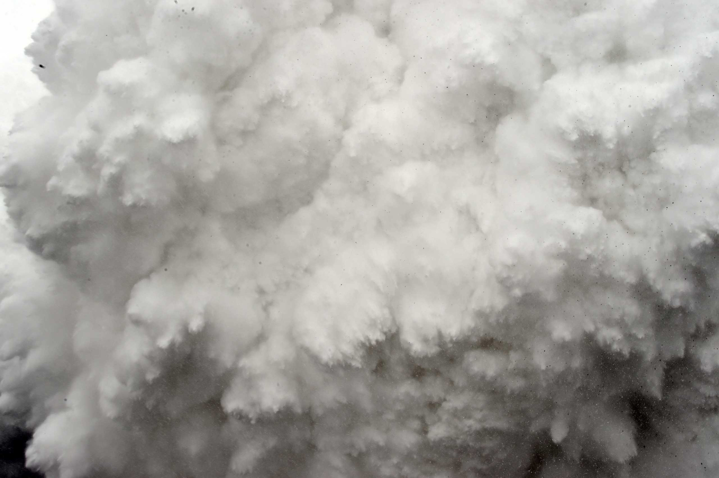 A cloud of snow and debris triggered by an earthquake flies towards Everest Base Camp, moments ahead of flattening part of the camp in the Himalayas on April 25, 2015.