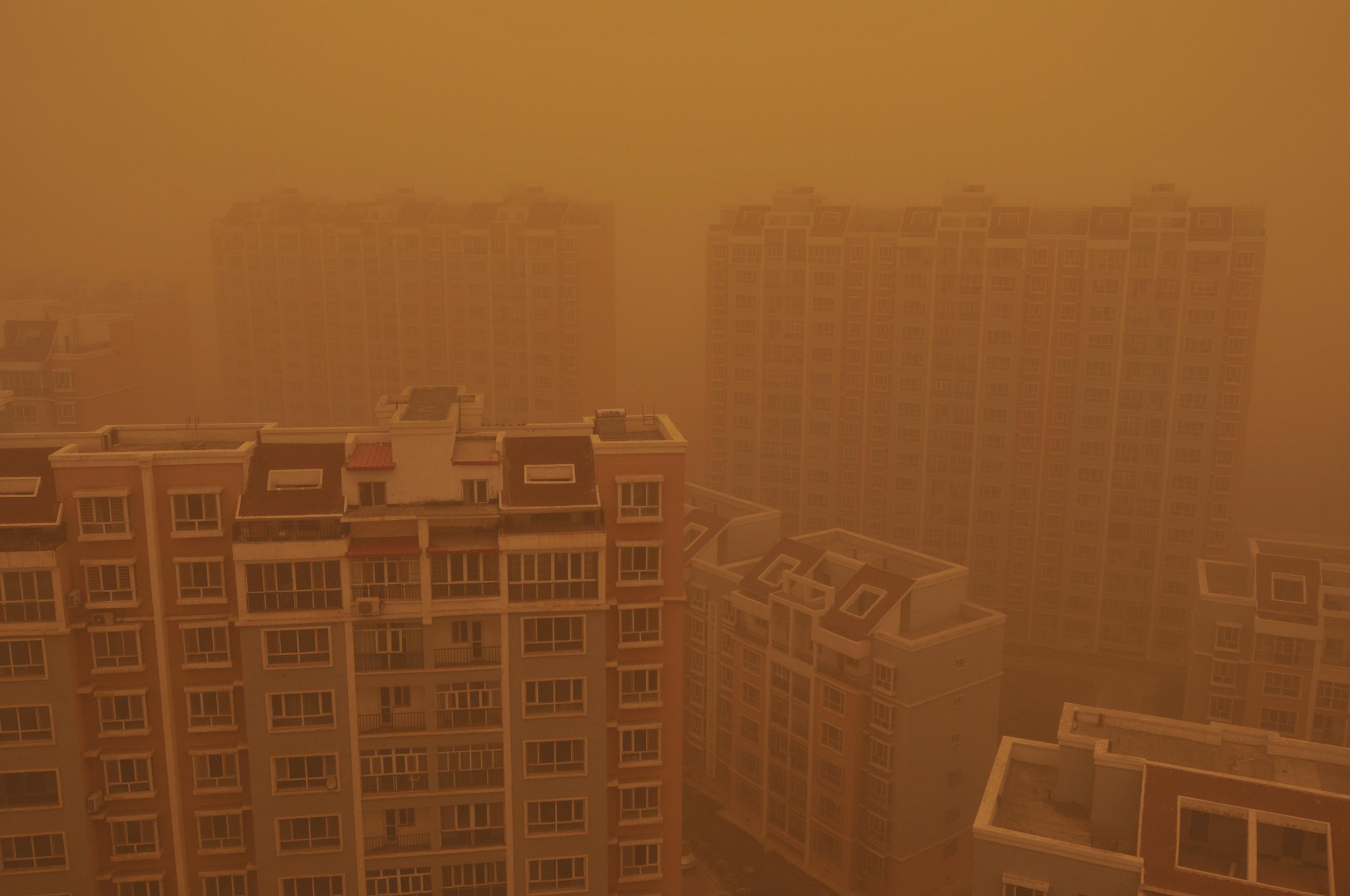 A view of residential apartment buildings during a sandstorm in Wujiaqu city, northwest China's Xinjiang Uygur Autonomous Region, on April 27, 2015.
