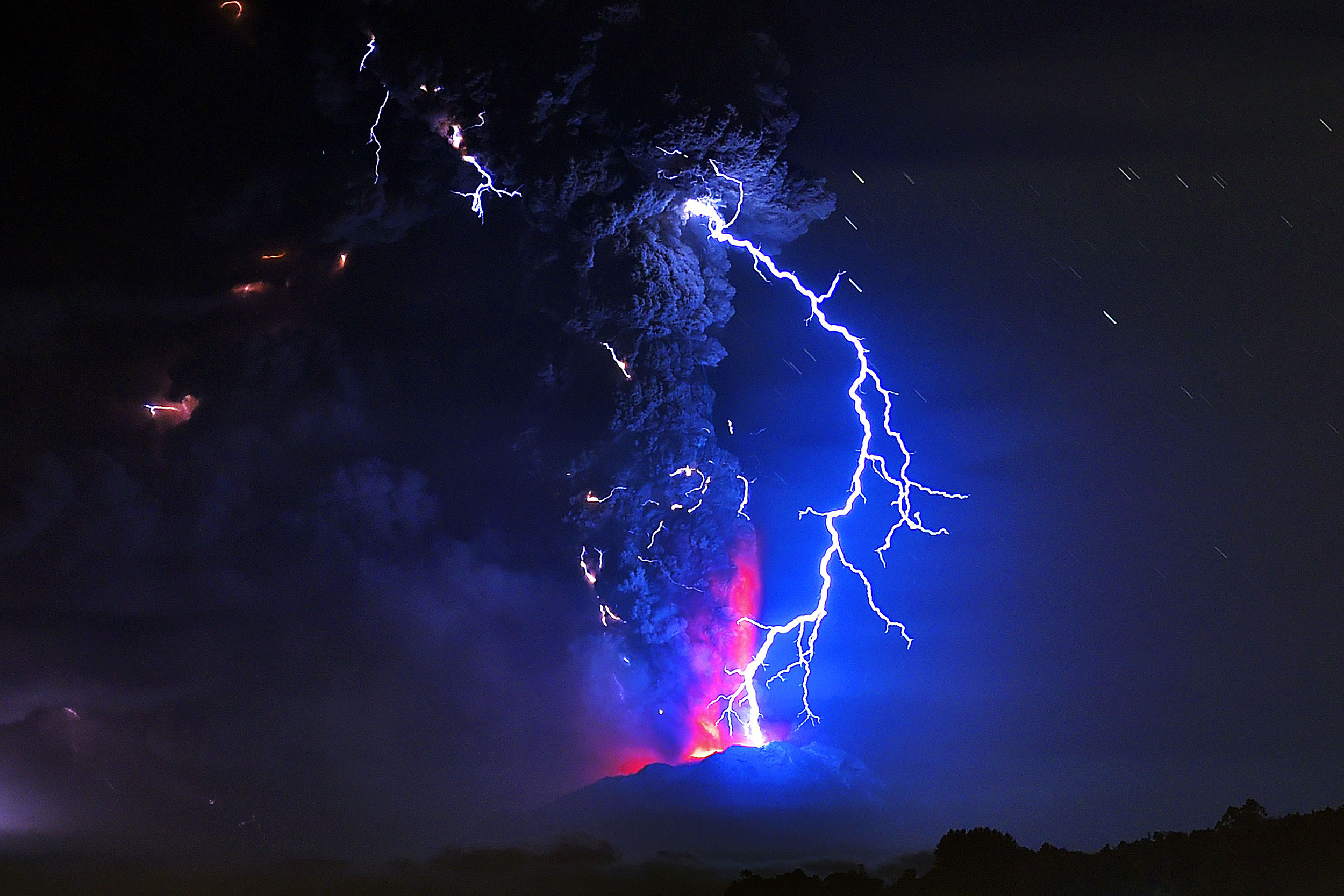 Volcanic lightning and lava spews from the Calbuco volcano in Frutillar, southern Chile on April 23, 2015.