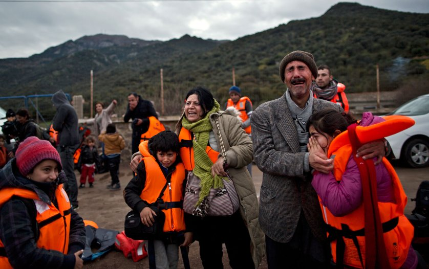 Yezidi refugee Samir Qasu, 45, from Sinjar, Iraq, and his wife Bessi, 42, cry while embracing two of their children, Dunia, 13, and Dildar, 10, shortly after arriving on a vessel from Turkey to the Greek island of Lesbos, Dec. 3, 2015.