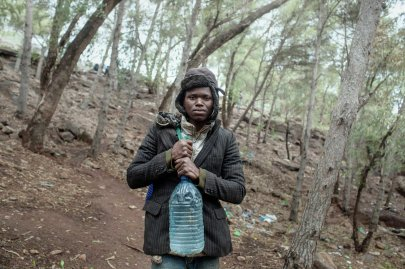 Portrait of a sub-Saharan migrant on Mount Gurugu, Nador, Morocco in 2012, where hundreds of African immigrants living in precarious conditions waited for the opportunity to cross the fence into Melilla, Spain. The enclave's border had heavy security, including a six-meter tall double fence with watchtowers.