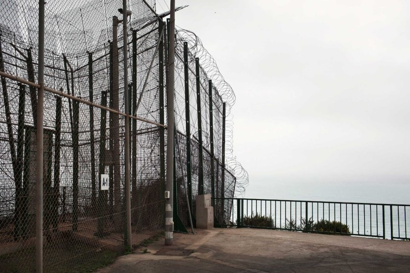 The border fence that divides the Moroccan city of Nador from the Spanish enclave of Melilla, in Northern Africa, 2012. The security fence which runs the full length of the border has heavy security, including a 19-foot-tall double fence with watchtowers, and is as a popular crossing for sub-Saharan migrants hoping to illegally reach Spain.