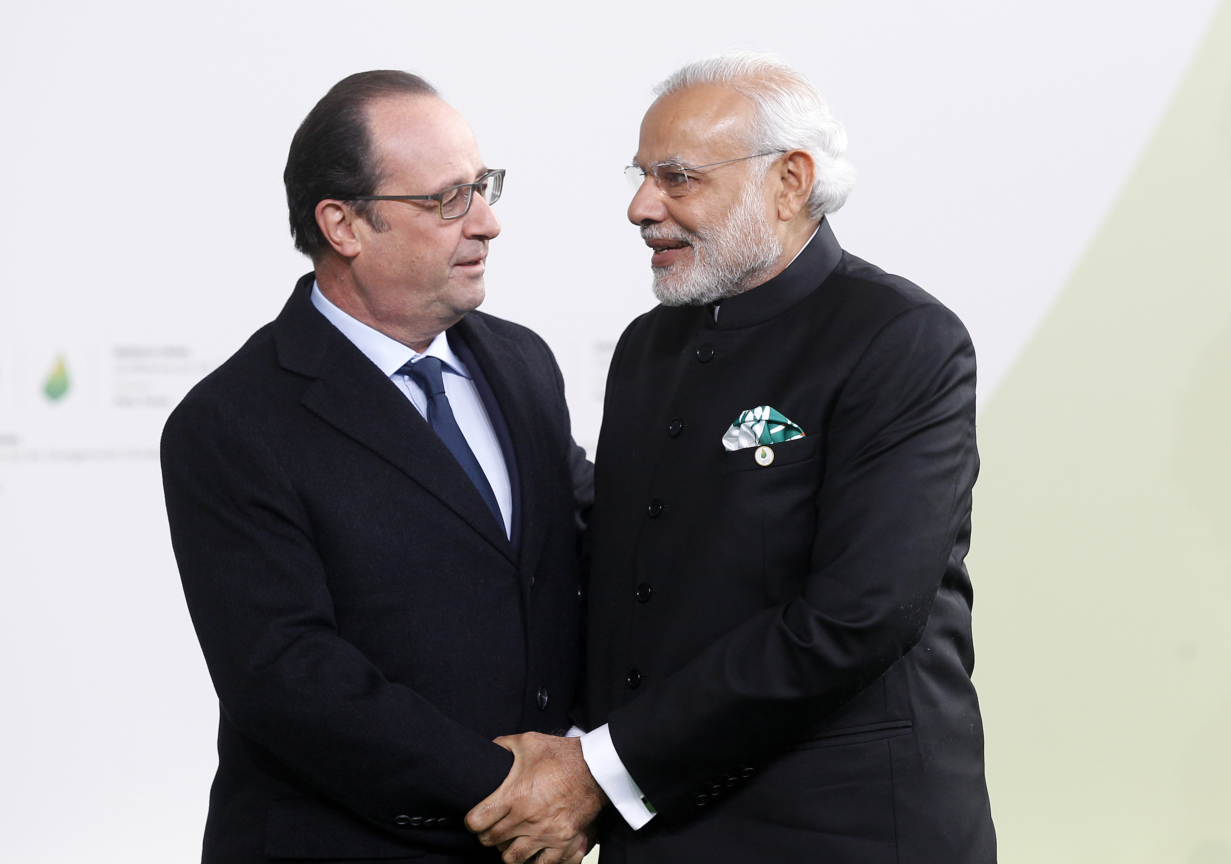 Francois Hollande shakes hands with Narendra Modi (R) as he arrives for the COP21 on Nov. 30, 2015 in Le Bourget, France.