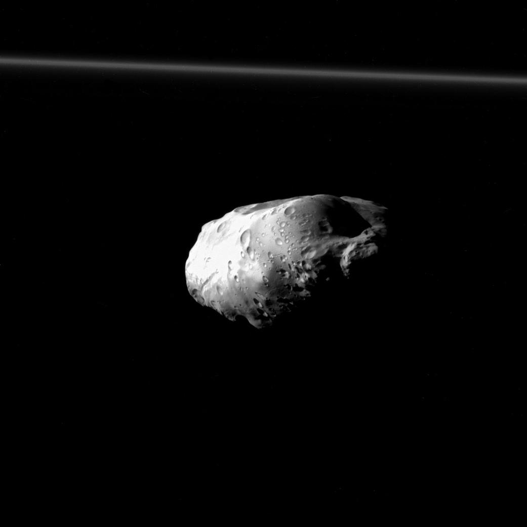Just 62 miles long, Saturn's little moon Prometheus is made mostly of ice with a studding of rock. It orbits on the inside of Saturn's F ring and its sister moon Pandora orbits on the outside. Together they gravitationally groom the ring, keeping its edges sharp. Cassini captured this image on Dec. 6, 2015.