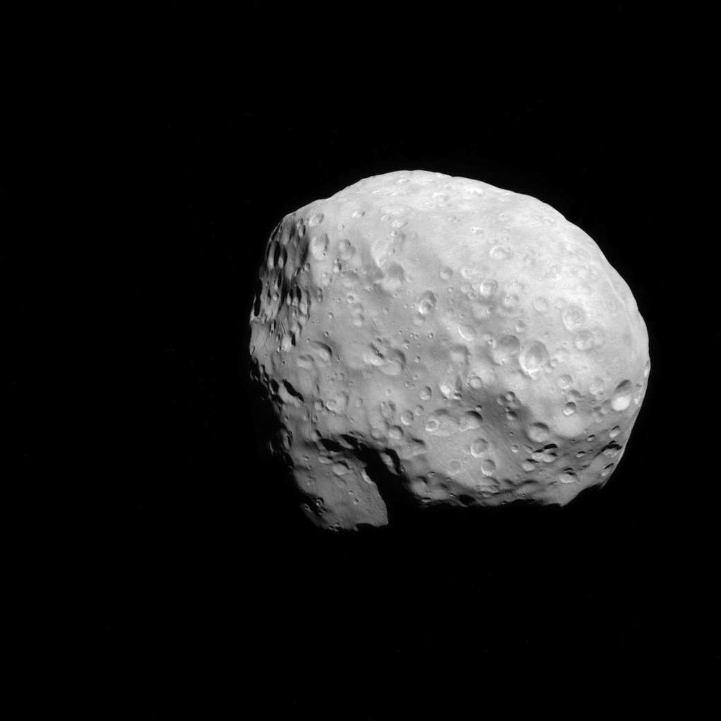 At just 74 miles long, Epimethus is one of Saturn's smallest moons, and it would be wholly unremarkable if it weren't for its relationship with its big sister moon, the 118-mile Janus. The two moons orbit within 31 miles of one another, with the one closer to Saturn moving slightly faster. Every 2,100 revolutions—about every four years—the tug of the leading moon flips the trailing one forward, and the two swap positions. Four years after, it happens again. This picture was taken on Dec. 6, 2015.