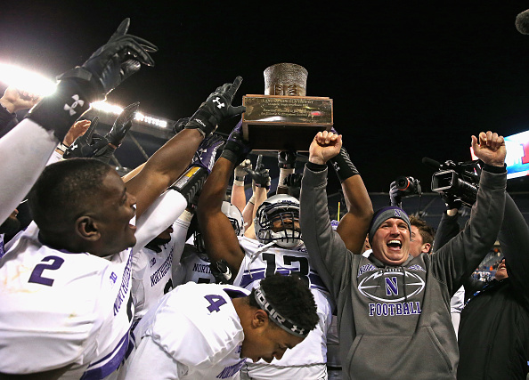 Northwestern celebrates winning  the  Land of Lincoln  trophy after the Wildcats defeated Illinois on November 28, 2015 in Chicago, Illinois.