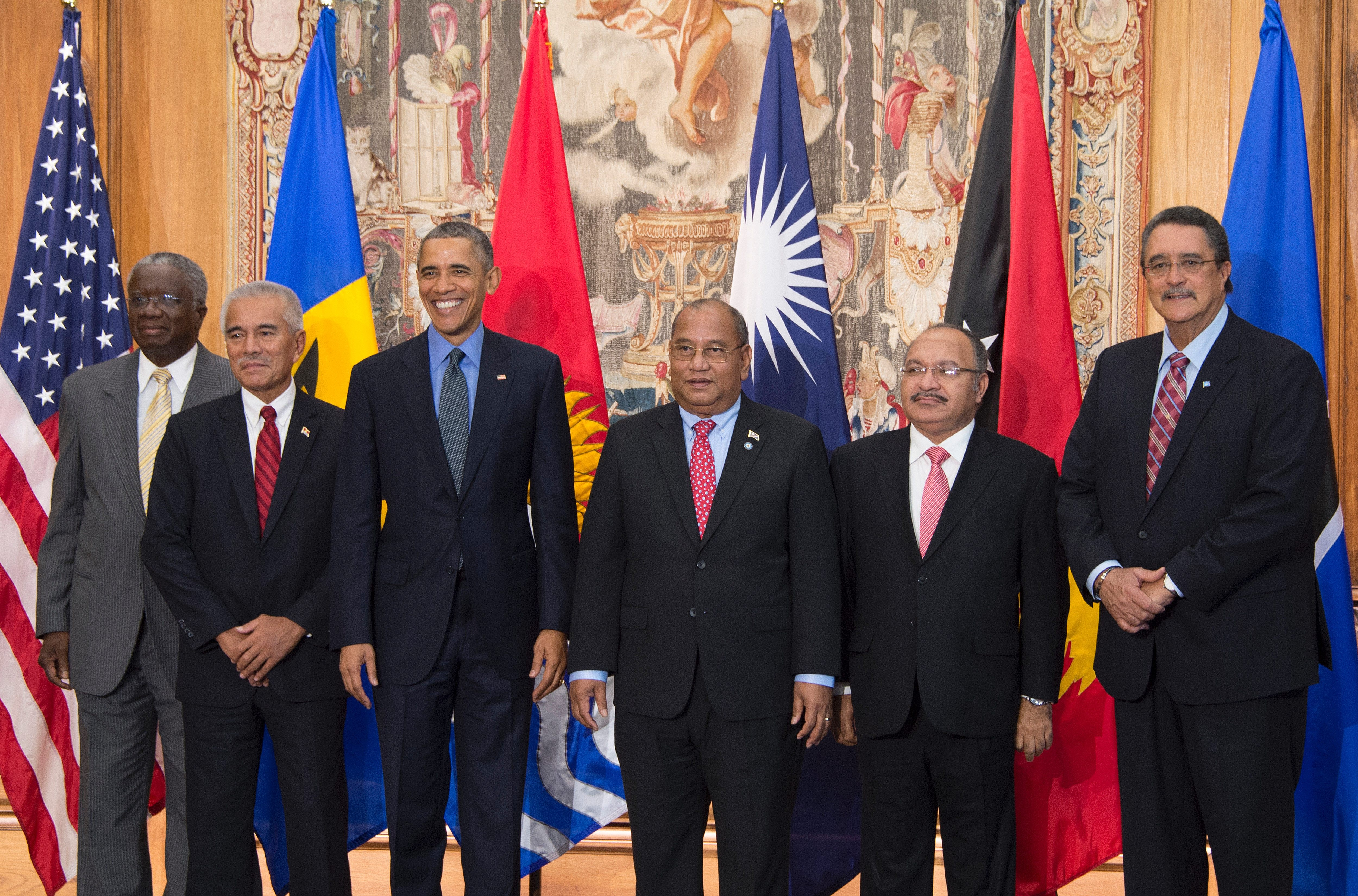 US President Barack Obama poses with, from left to right, Barbados Prime Minister Freundel Stuart, Kiribati President Anote Tong, Marshall Islands President Christopher Loeak, Papua New Guinea Prime Minister Peter O'Neil and St. Lucia Prime Minister Kenny Anthony during a family photo for the small island nations in Paris on Dec. 1.