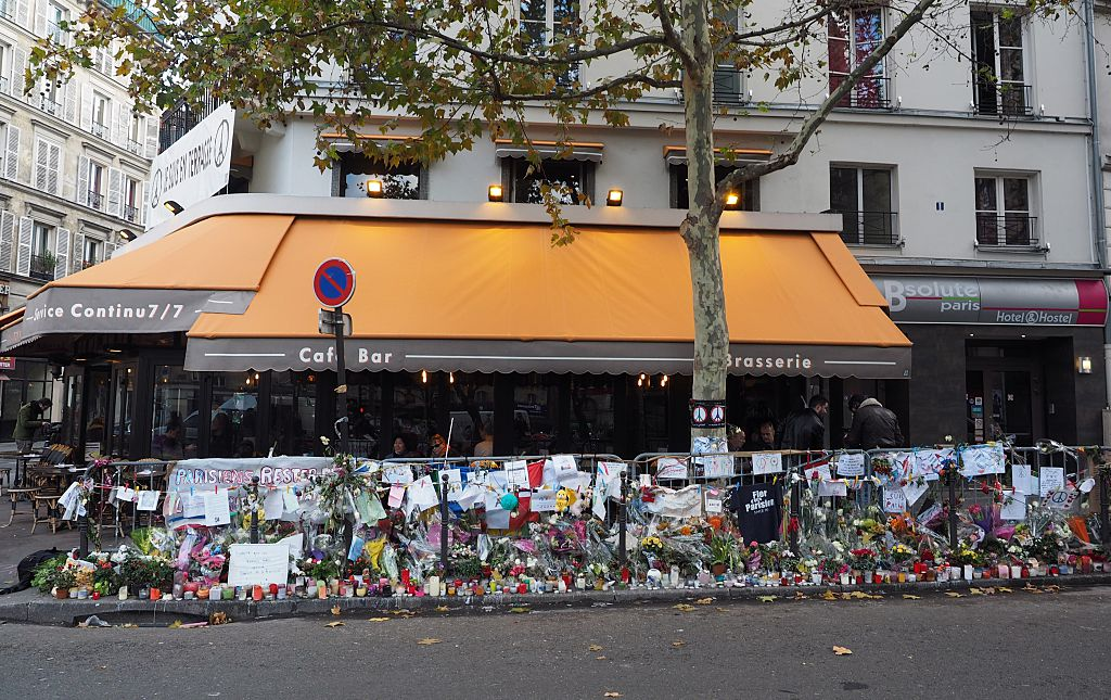 Flowers and notes are seen outside one of the cafes targeted in the Nov. 13 Paris terror attacks.