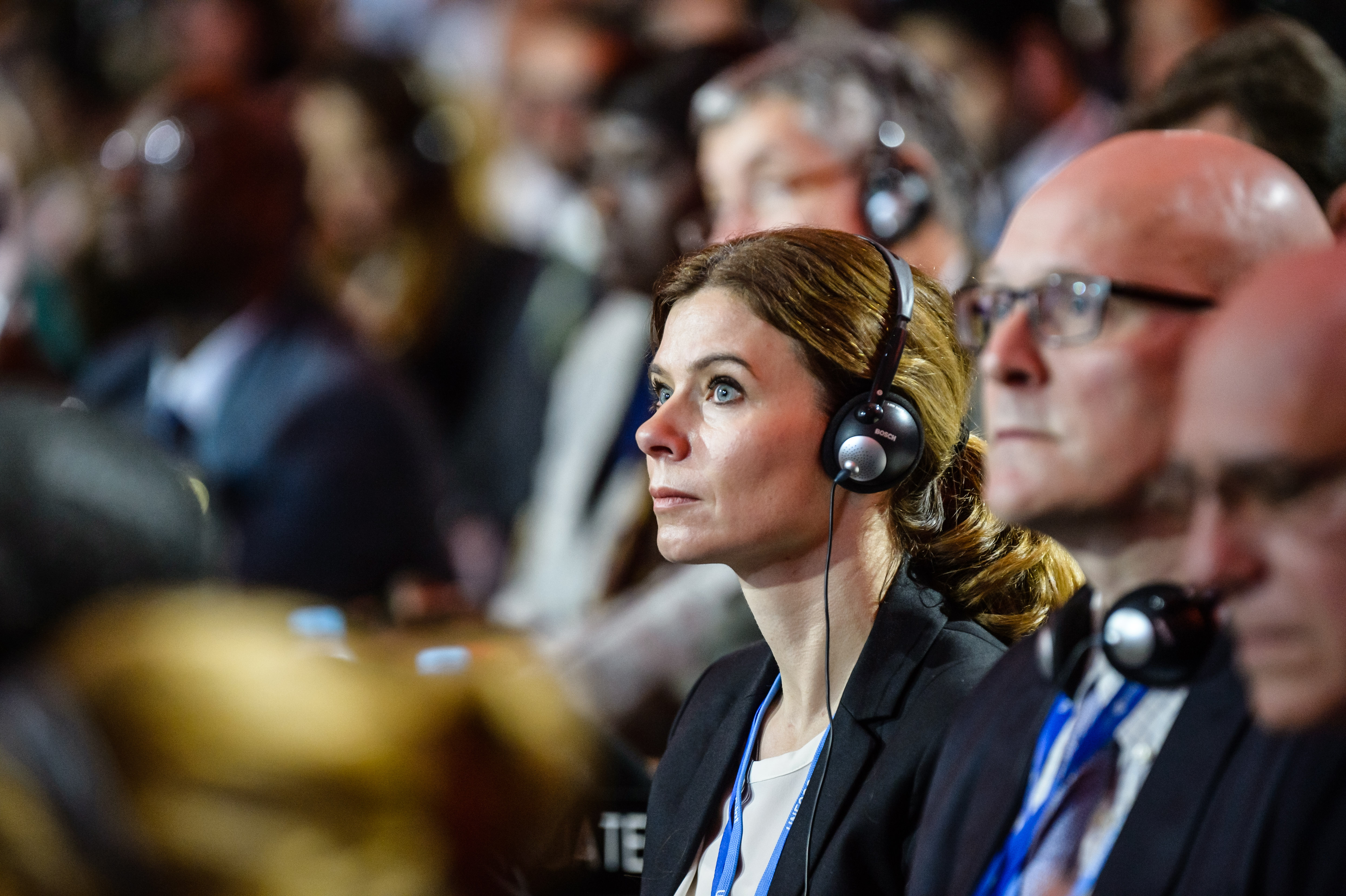 Members of the states delegations listen to the speech of Laurent Fabius during the plenary session where the final agreement of the COP21 in Paris on Dec. 12, 2015.