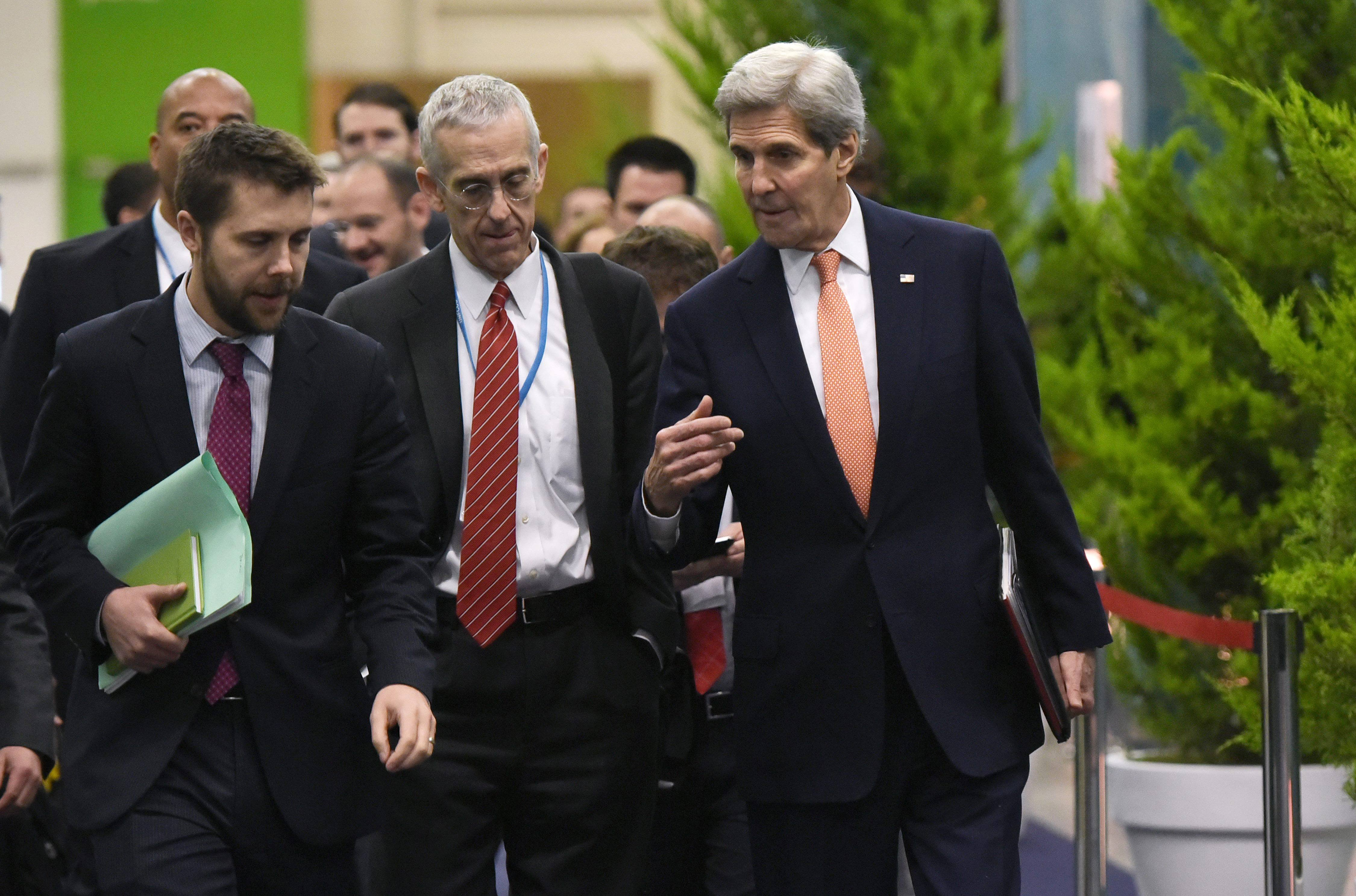 US Secretary of State John Kerry, right, walks with White House senior advisor Brian Deese, left, and US Special Envoy for Climate Change Todd Stern, center, to attend a meeting with French Foreign Minister during the COP 21 United Nations conference on climate change at Le Bourget, on the outskirts of Paris, on Dec. 10, 2015.