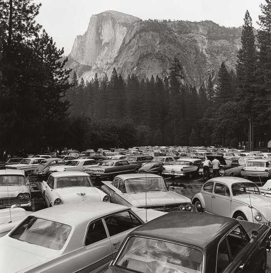 A crowded parking lot at the base of Half Dome in Yosemite National Park in 1965, entitled, Pave It and Paint It Green.