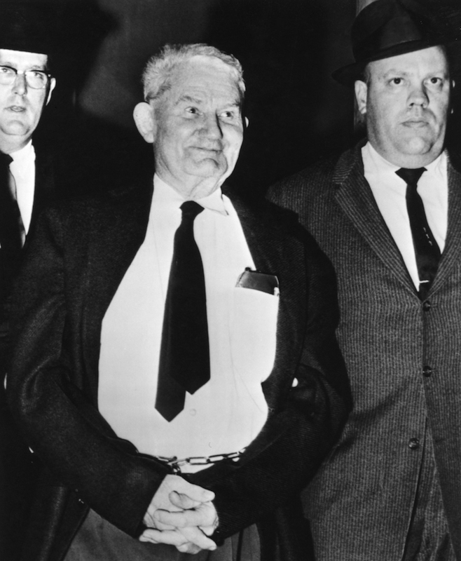 Richard Paul Pavlick is led into a courtroom by James Couch, Chief Deputy U.S. Marshall of Kansas City, right, in Springfield, MO. on Feb. 2, 1962.