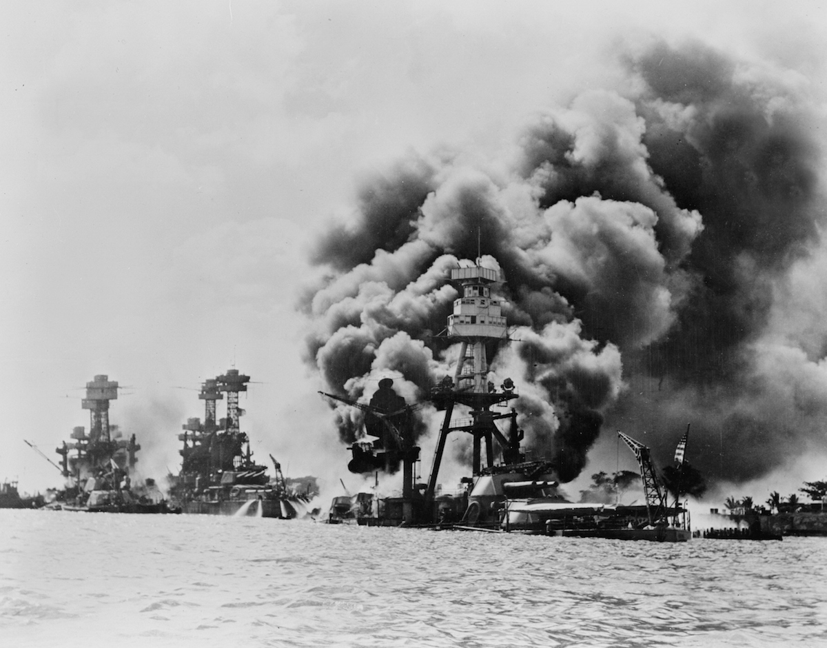 Three stricken US battleships—left to right, West Virginia, Tennessee and Arizona—after the Japanese attack on Pearl Harbor on Dec. 7, 1941.