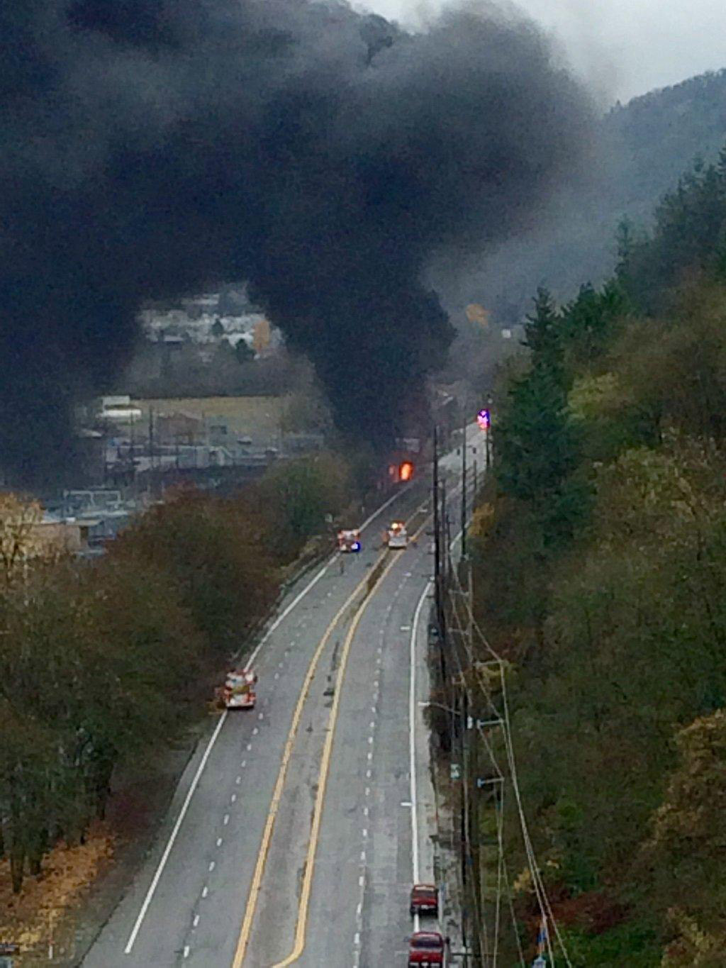 The scene of a of a traffic crash and fire involving a train along U.S. 30/St. Helens Road in Northwest Portland, Ore., on Dec. 13, 2015.