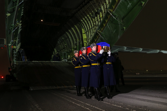 The body of Russian pilot Oleg Peshkov arrived in Moscow on Monday.
