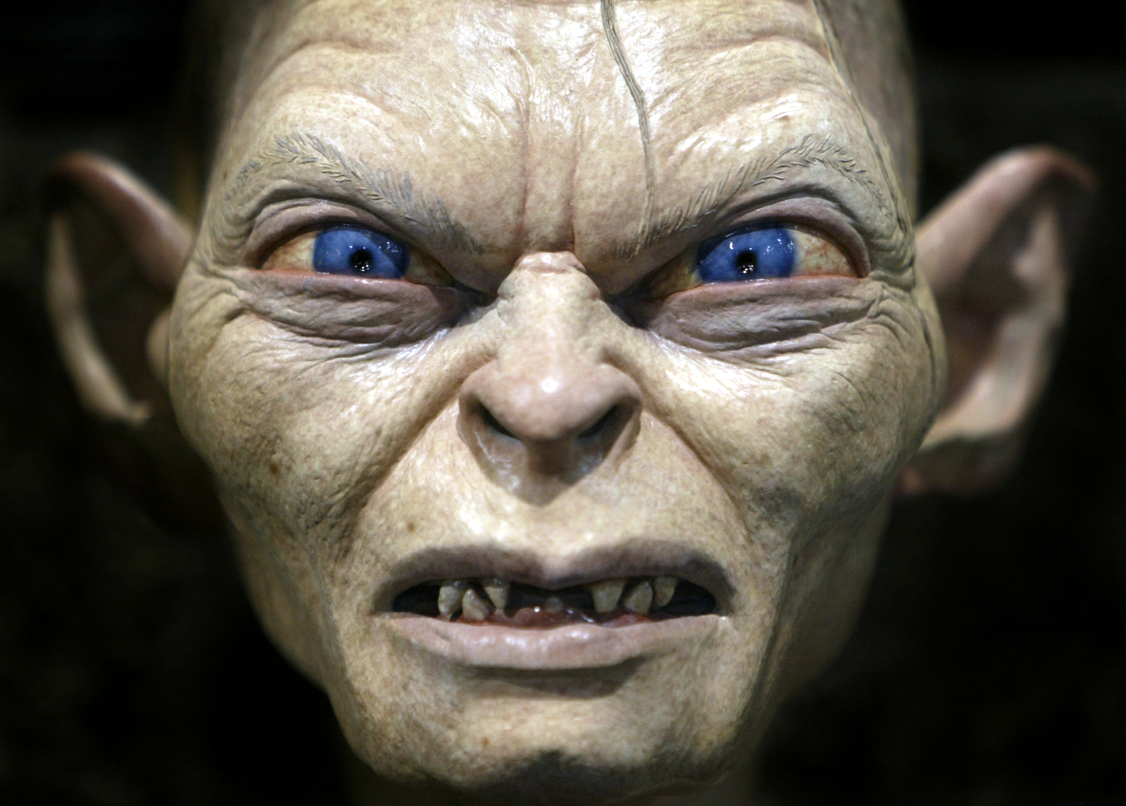 Gollum, a special-effects creature from the movie Lord of the Rings,                    is on display at the annual four-day Comic Con convention in San Diego on July 18, 2003. Thousands of fans from around the world gather to peruse                   a collection of comic books and industry-related sci-fi, video and                   motion-picture fantasy products