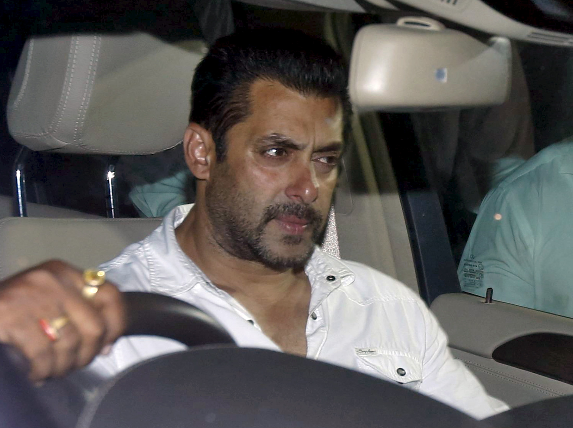 Bollywood actor Salman Khan sits in a car as he leaves a court in Mumbai on May 6, 2015