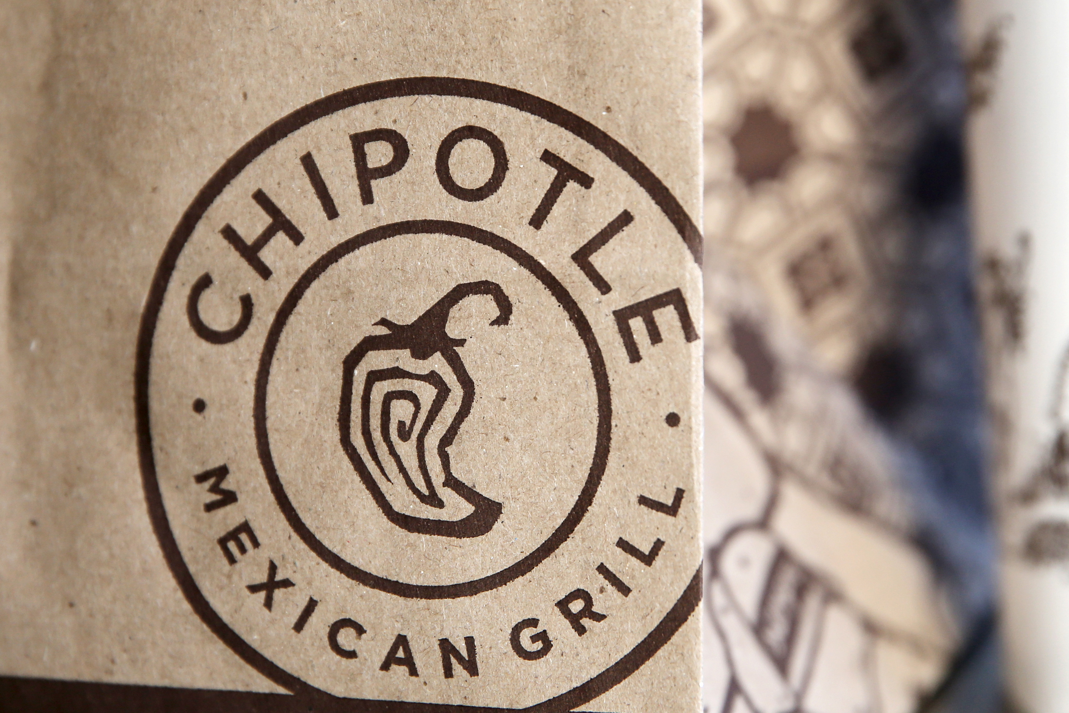 A logo of Chipotle Mexican Grill is seen on one of their bags in Manhattan, New York City, on Nov. 23, 2015