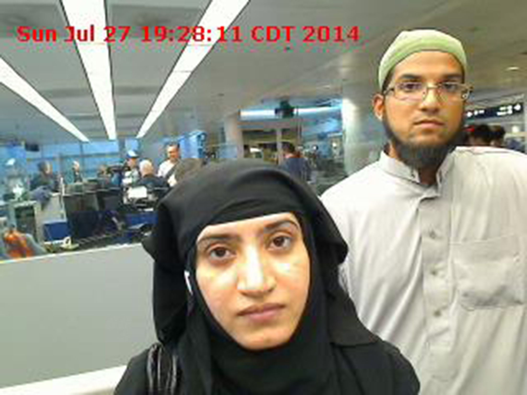 Tashfeen Malik, left, and Syed Rizwan Farook are pictured passing through Chicago's O'Hare International Airport in this July 27, 2014, handout photo obtained by Reuters on Dec. 8, 2015