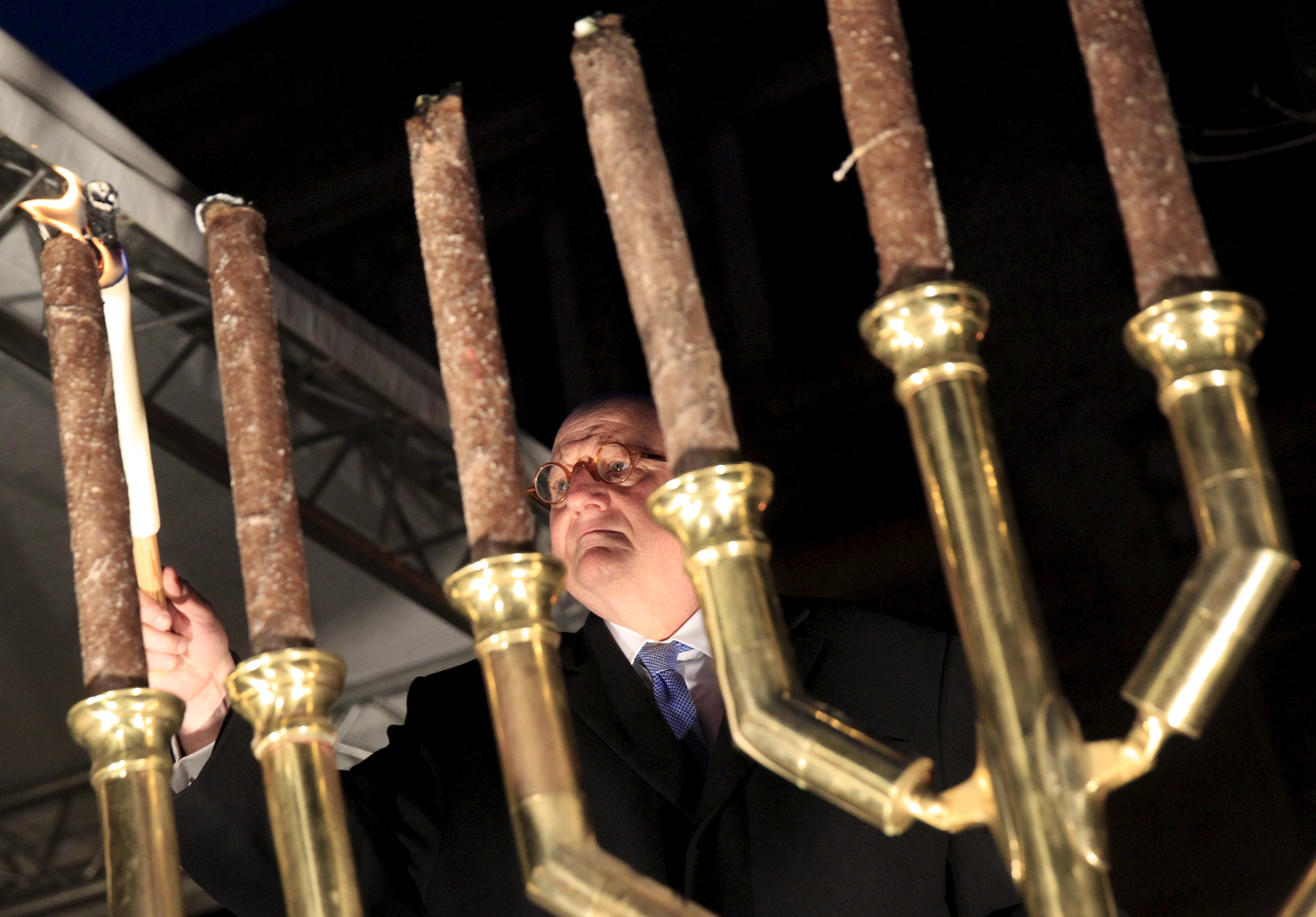 Ira Forman, U.S. special envoy of the Office to Monitor and Combat Anti-Semitism, lights a menorah during a protest organized by a Jewish group against a planned statue of Balint Homan in Szekesfehervar, Hungary, on Dec. 13, 2015