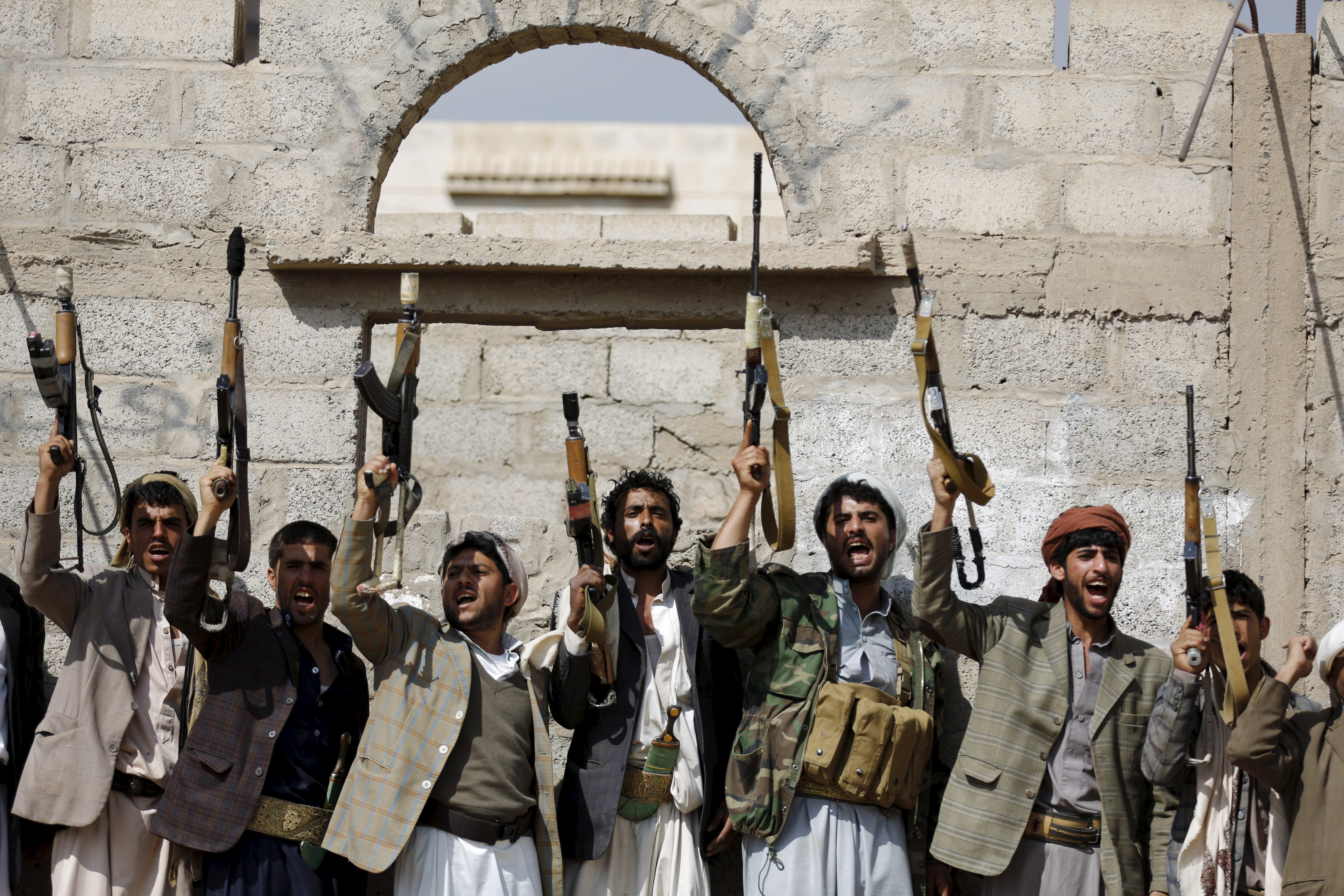 Tribesmen loyal to the Houthi forces shout slogans and raise their weapons during a gathering in Yemen's capital Sana'a on Dec. 15, 2015