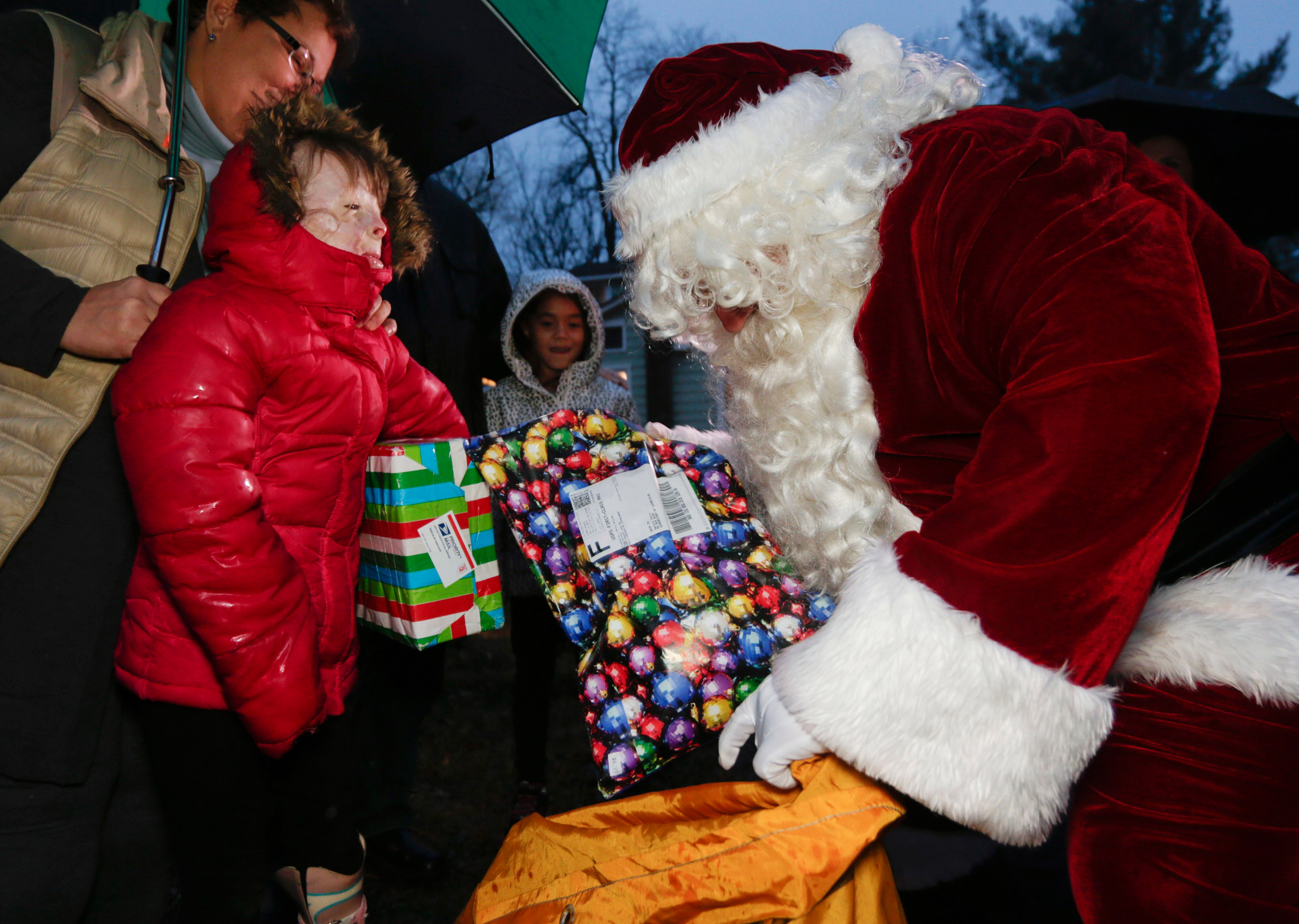 Safyre Terry receives packages from Santa Claus in Rotterdam, N.Y., on Dec. 17, 2015.