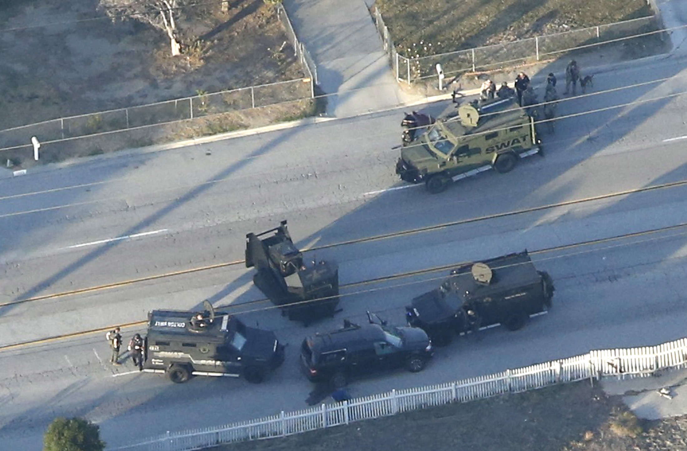 An SUV with its windows shot out that police suspect was the getaway vehicle from at the scene of a shooting in San Bernardino, California is shown in this aerial photo on Dec. 2, 2015.