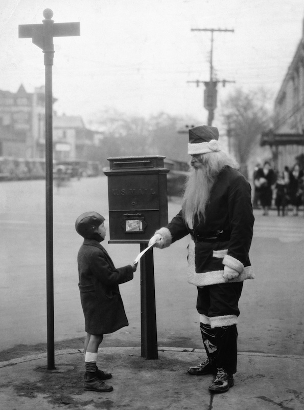 Clyde Snipes hands a letter Santa Claus in South Carolina on Dec. 24, 1932