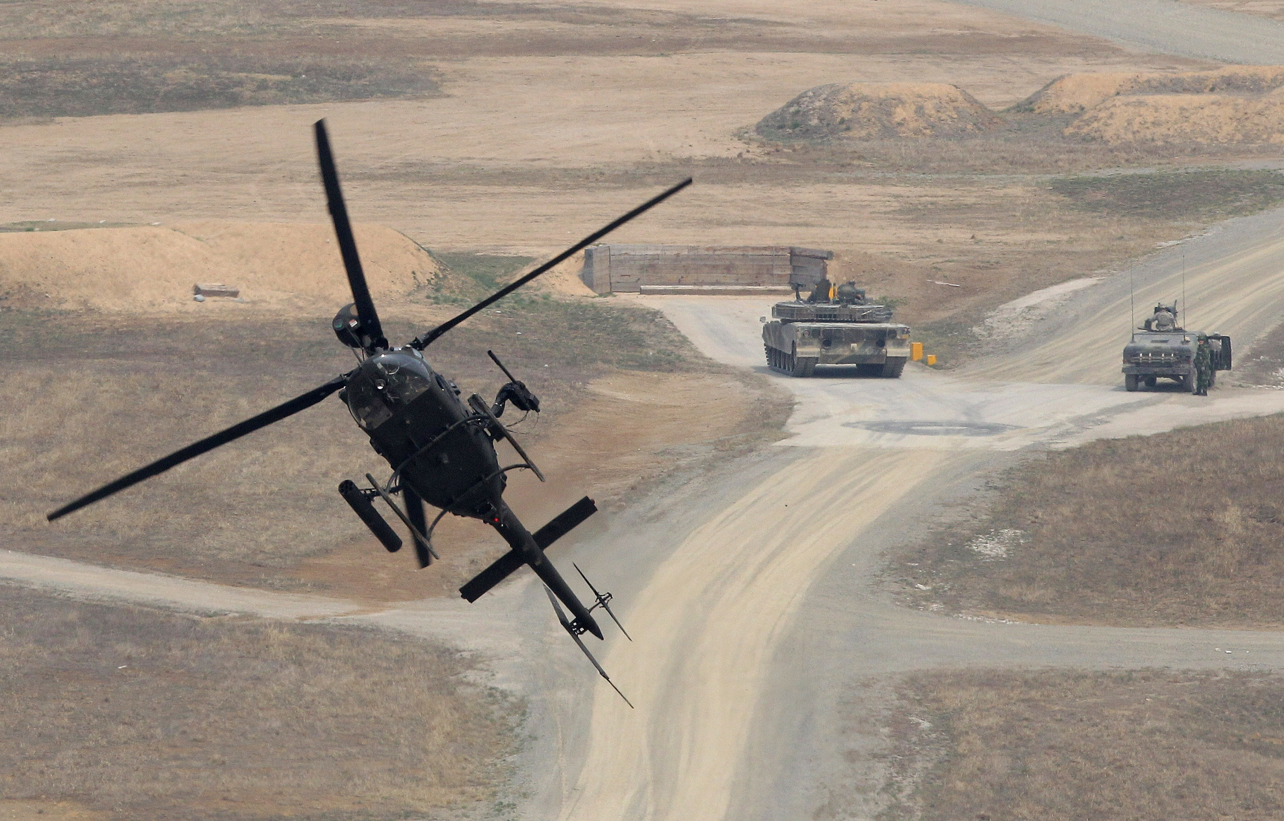 A Kiowa Warrior helicopter hover during the United States and South Korean Joint live fire Exercise at Rodriguez Range in Pocheon, South Korea, on Apr. 11, 2014.
