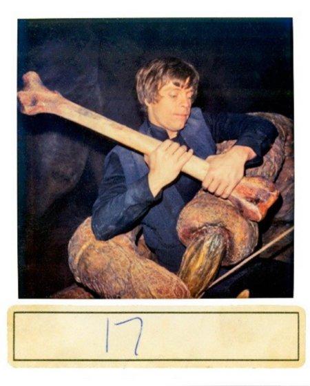 Luke Skywalker in the grip of the rancor.