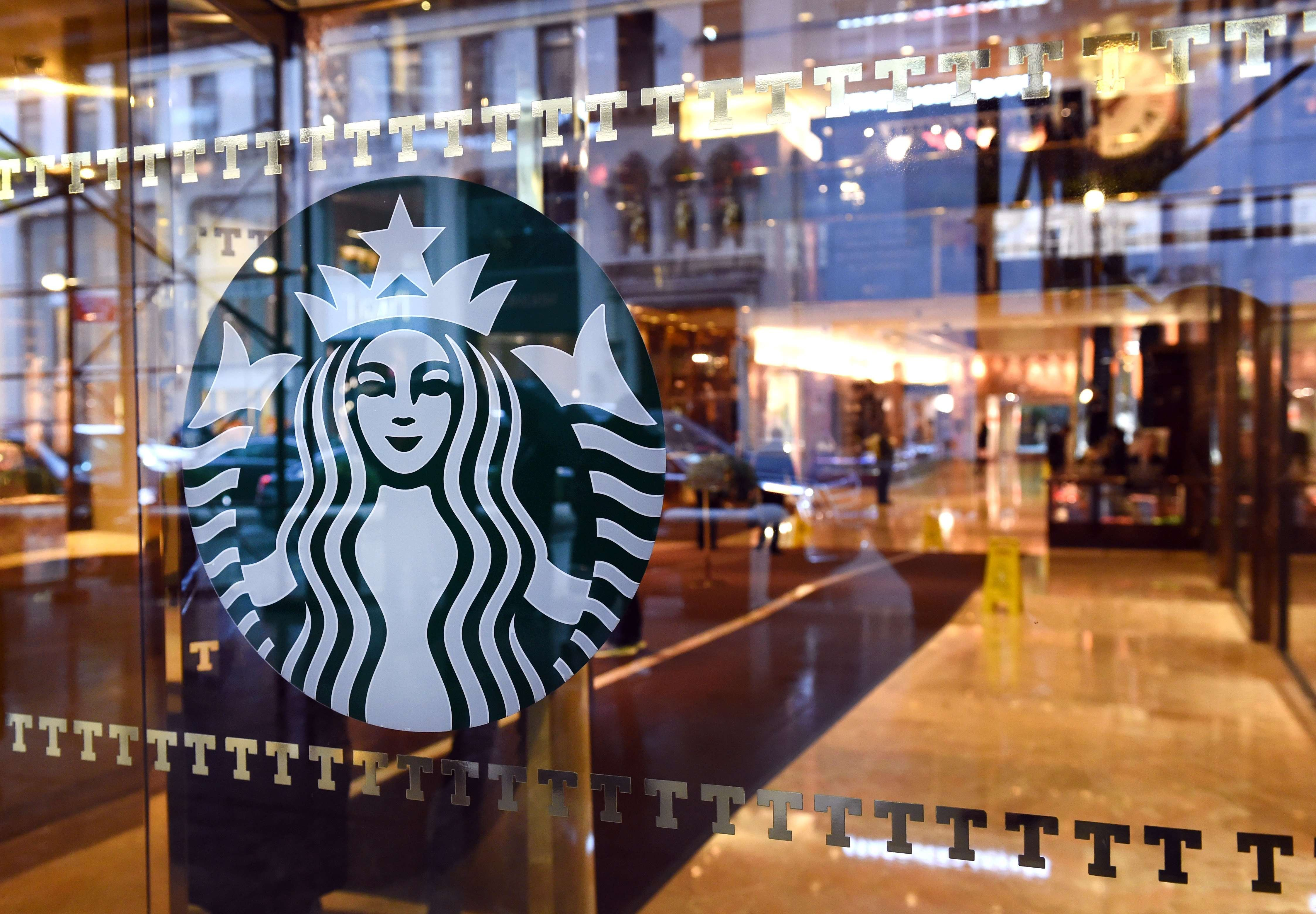 The Starbucks sign is seen at a store located in Trump Tower on 5th Avenue in New York Nov. 10, 2015.